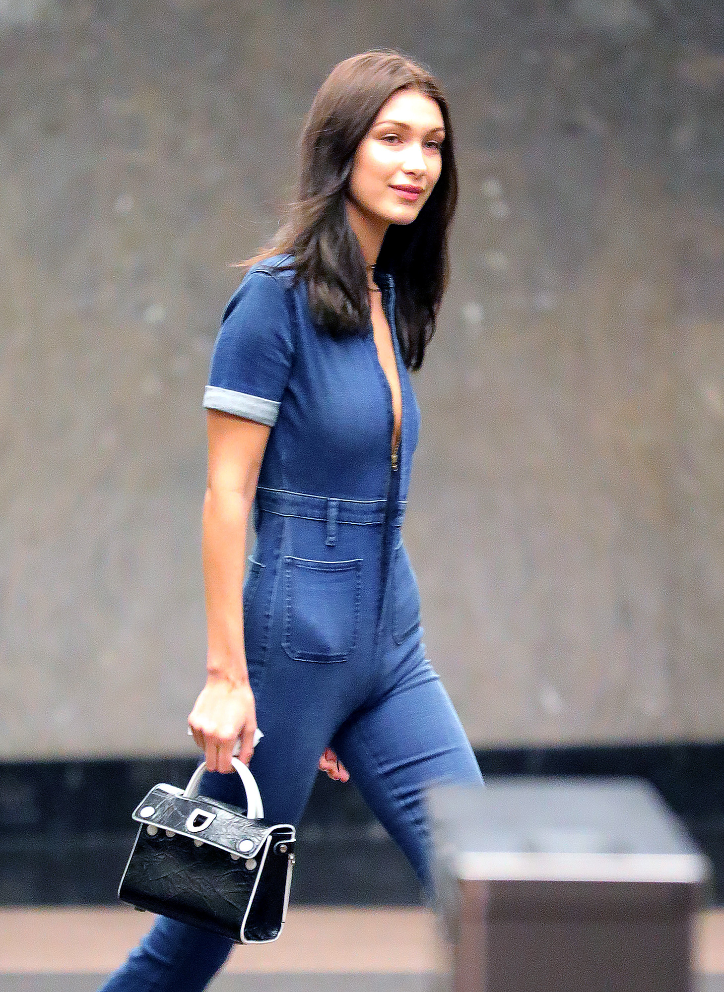 Bella Hadid wears a cleavage-bearing, body-hugging denim outfit when out and about in New York City
