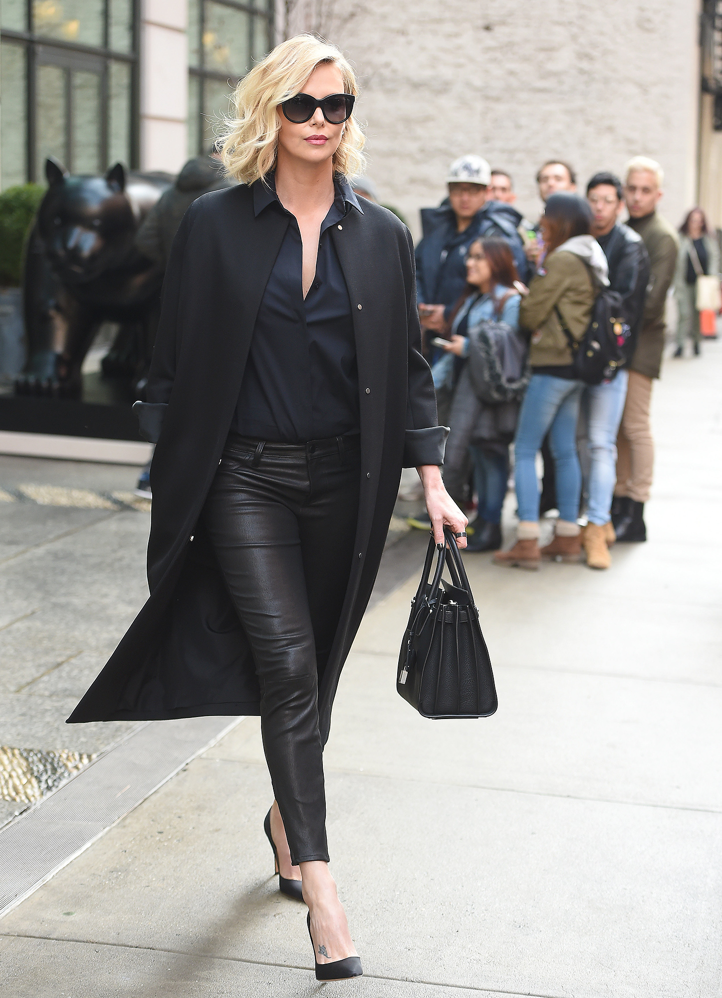 Charlize Theron seen wearing black leather pants in New York City