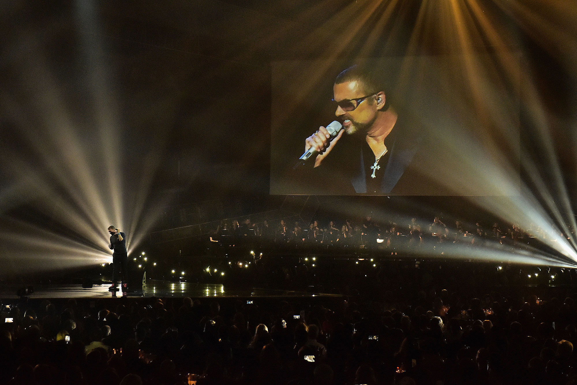 LONDON, ENGLAND - FEBRUARY 22: (EDITORIAL USE ONLY) Chris Martin performs a tribute to George Michael on stage at The BRIT Awards 2017 at The O2 Arena on February 22, 2017 in London, England. (Photo by Gareth Cattermole/Getty Images)