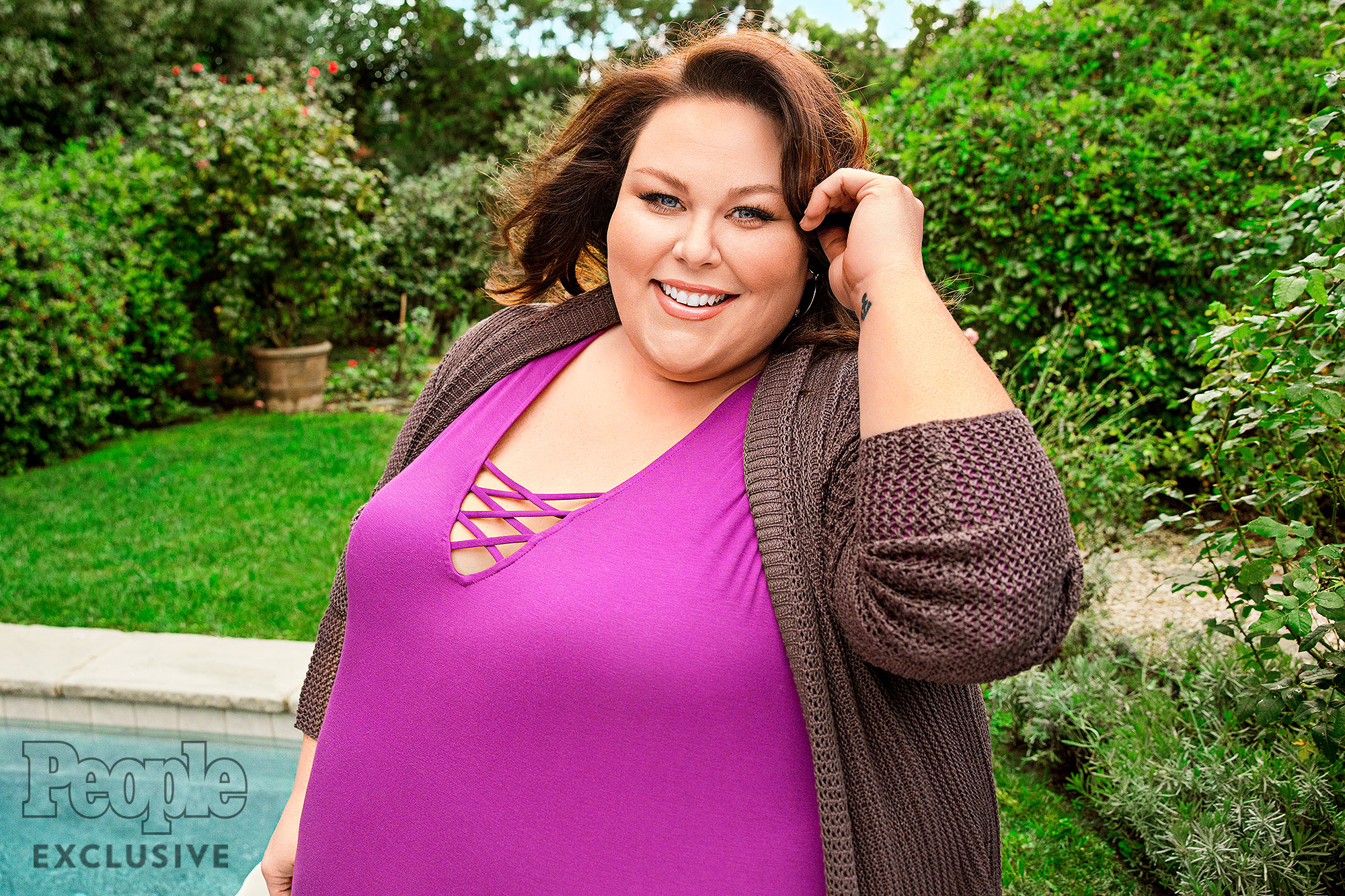Chrissy Metz photographed in Los Angeles, CA, on January 13, 2017. THIS IS A HIGH RES RETOUCHED FILE Photographer: Jim Wright Hair: Stephanie Hobgood/Hot Tools Pro/Exclusive Artists Management Makeup: Motoko Honjo Clayton/NARS/MAC Stylist: Jordan Grossman Clothing Credits: Look 1 (in fuschia top): Sweater - Torrid Top - Lane Bryant Jeans - Lane Bryant Boots - Avenue Earrings - Rebecca Minkoff Look 2 (in green dress): Dress - Torrid Tights - Lane Bryant Earrings - Charlie Lapson Look 3 (grey striped sweater): Sweater - Lane Bryant Jeans - Torrid Earrings - Charlie Lapson