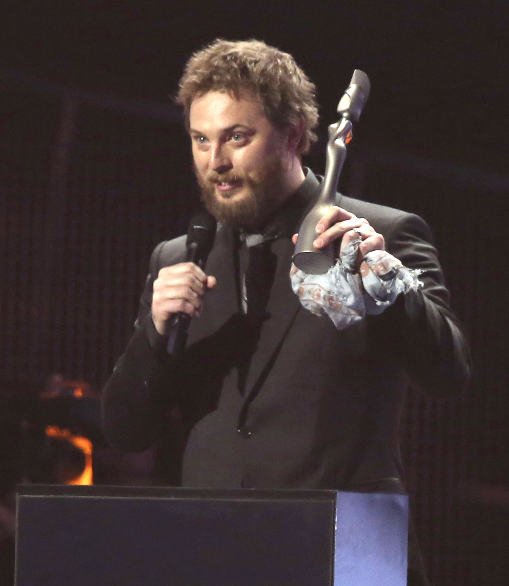 Duncan Jones, right, son of the late David Bowie, accepts the award for Album Of The Year on behalf of his father on stage at the Brit Awards 2017 in London, Wednesday, Feb. 22, 2017. (Photo by Joel Ryan/Invision/AP)