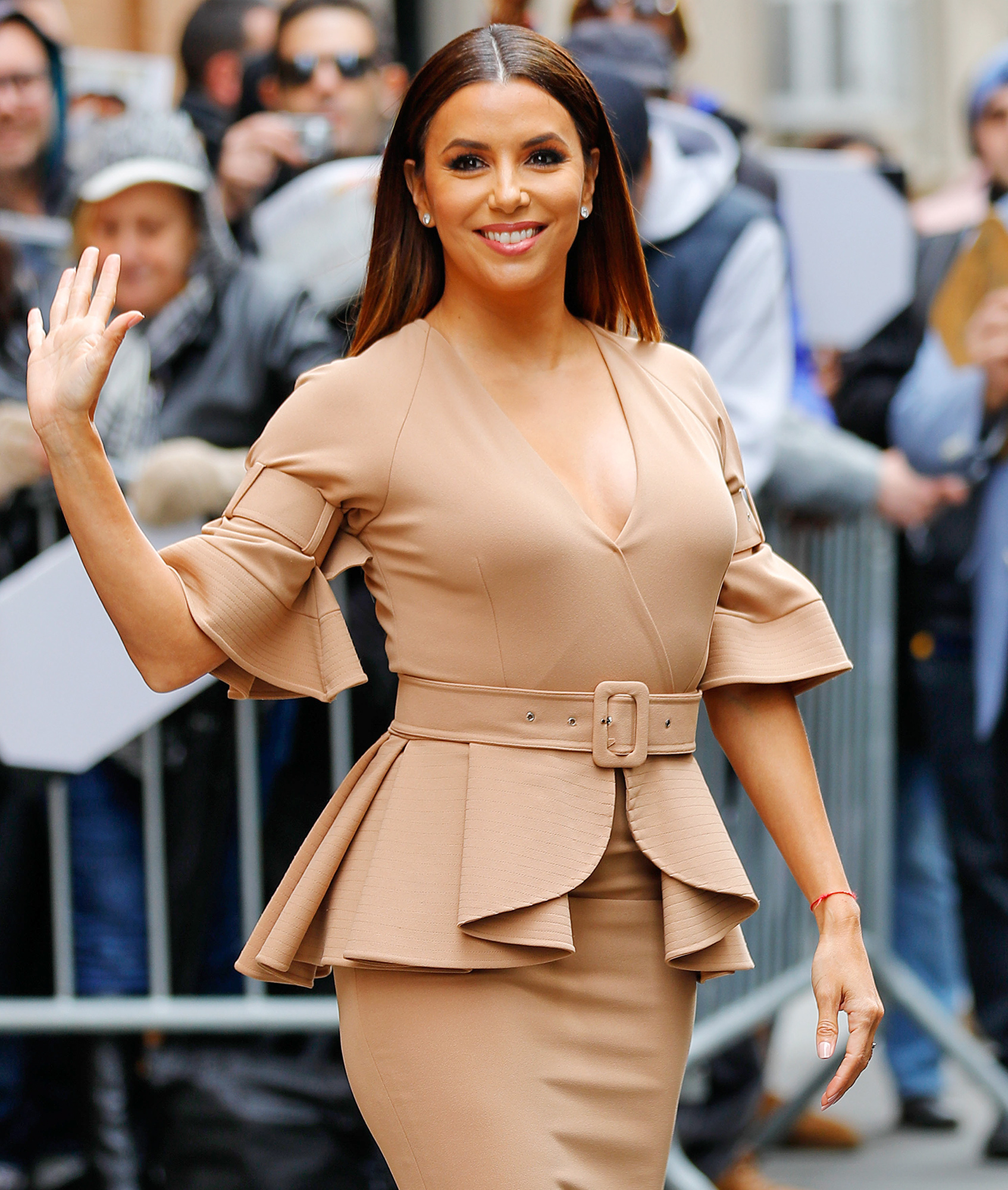 Eva Longoria shows off her curvaceous figure when departing The View studios in New York