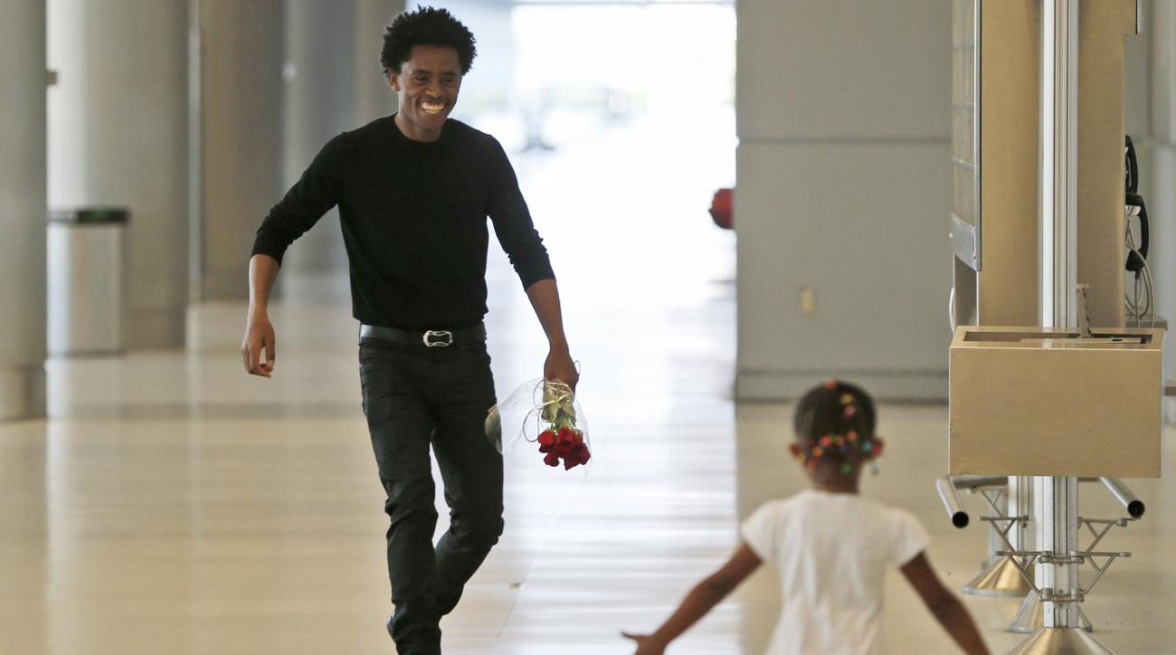 feyisa-lilesa-reunited-with-family-oromo-protests