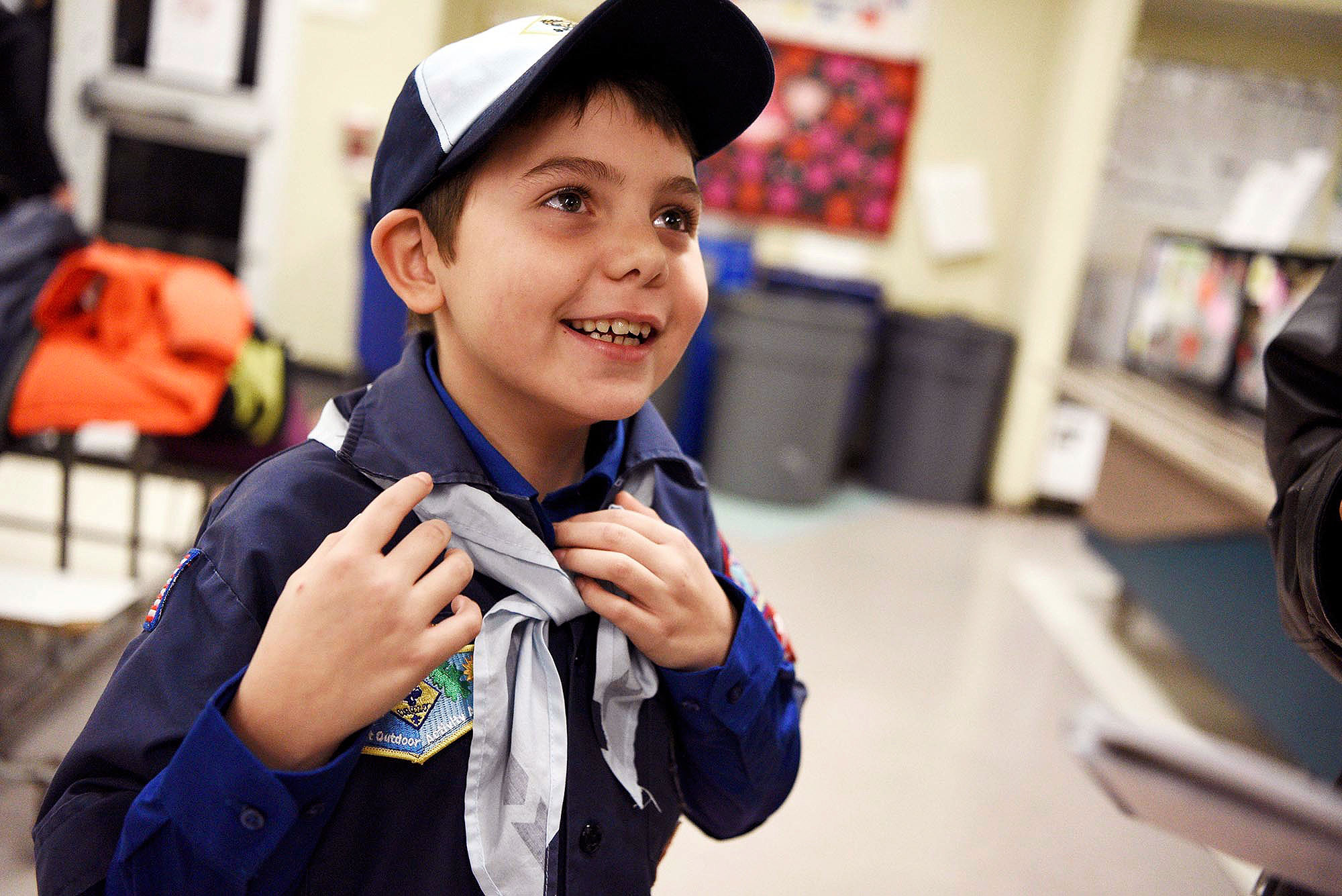 """In this Feb. 7, 2017 photo, Joe Maldonado, the first openly transgender member of the Boy Scouts, shows off the uniform he received from Scout leader Kyle Hackler to wear to his first meeting in Maplewood, N.J. Boy Scouts of America recently changed its policy to allow transgender children to join the organization. """"I am accepted,"""" Maldonado said as he put on the uniform. (Amy Newman/The Record via AP)"""