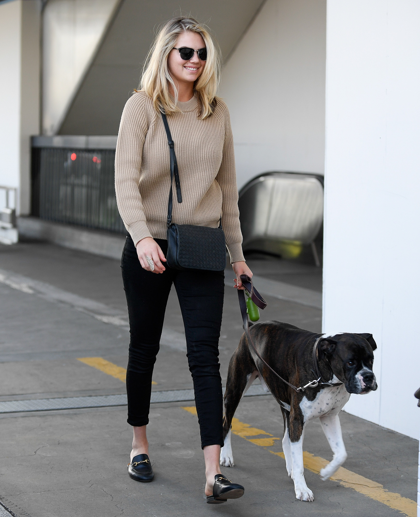 EXCLUSIVE: Kate Upton and her dog catch a flight out of LAX Airport