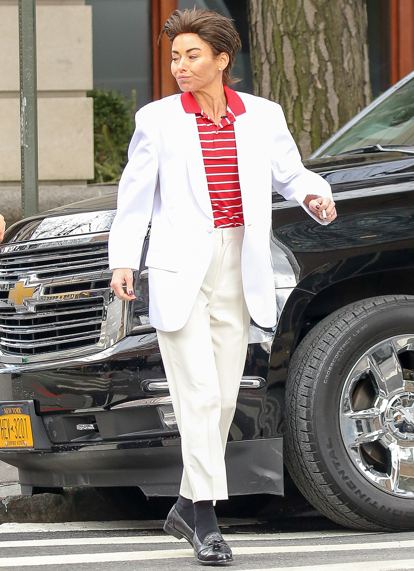EXCLUSIVE: Kelly Ripa spotted wearing a white suit and a Man's WIG while filming scenes for the Live With Kelly show in New York City part 2