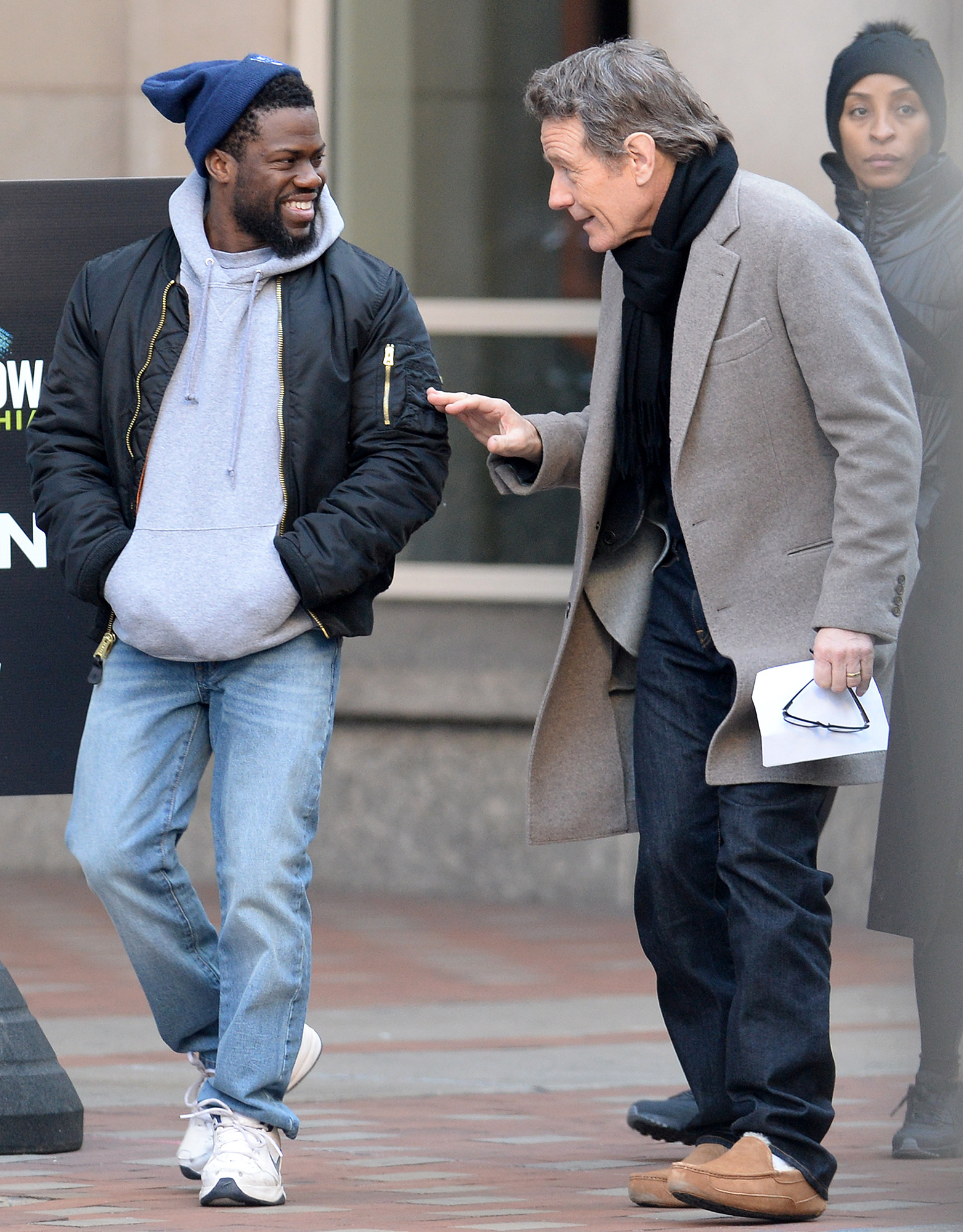Kevin Hart and Bryan Cranston enjoy some laughs between takes on the set of Untouchable filming in Philadelphia, Pa.