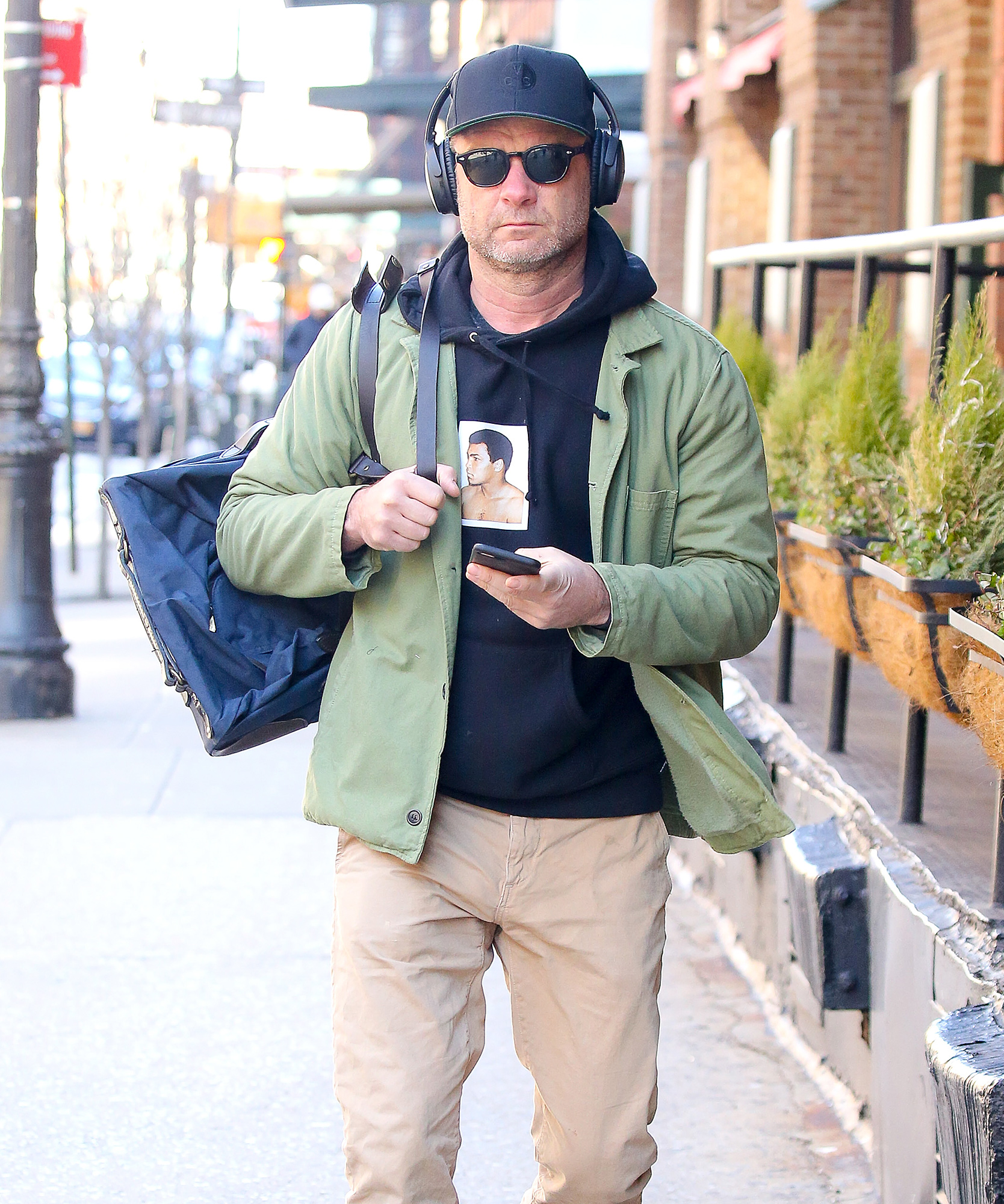 EXCLUSIVE: Liev Schreiber goes incognito while walking around in Tribeca, New York City