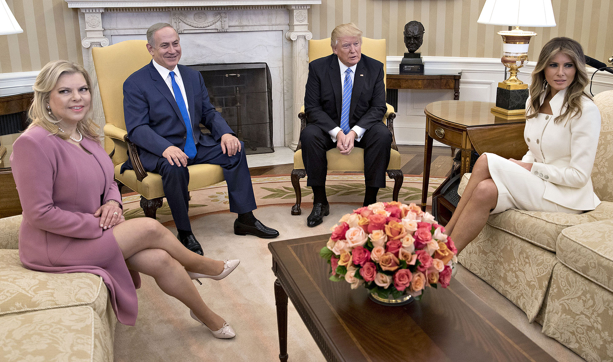 WASHINGTON, D.C. - FEBRUARY 15: (AFP OUT) U.S. President Donald Trump, Israel Prime Minister Benjamin Netanyahu, his wife Sara Netanyahu (L) and U.S. first lady Melania Trump sit in the Oval Office of the White House on February 15, 2017 in Washington, D.C. Netanyahu is trying to recalibrate ties with the new U.S. administration after eight years of high-profile clashes with former President Barack Obama, in part over Israel's policies toward the Palestinians. (Photo by Andrew Harrer-Pool/Getty Images) Getty Images North America 635483868