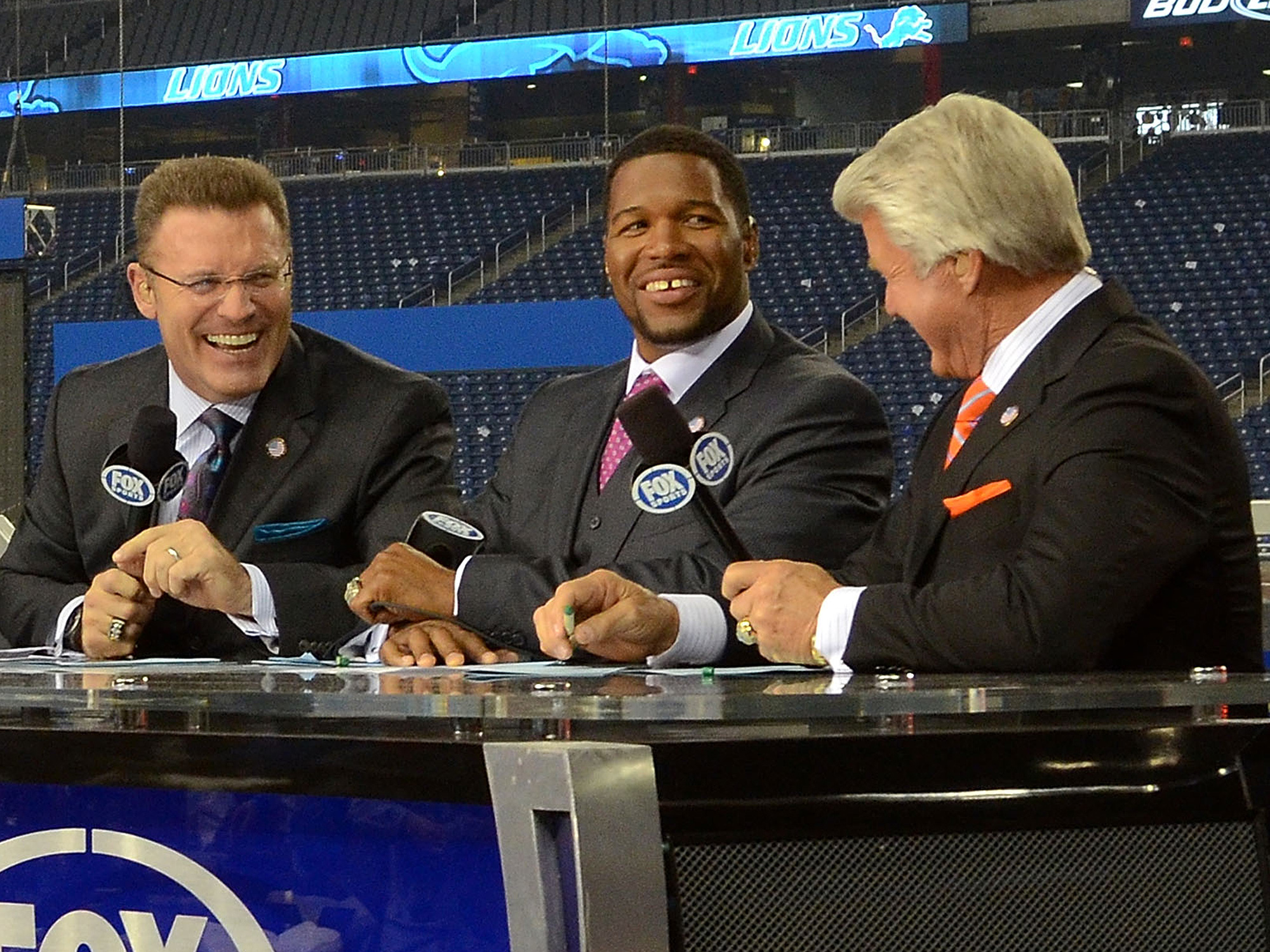 DETROIT, MI - NOVEMBER 24: Terry Bradshaw, Howie Long, Michael Strahan and Jimmy Johnson (L-R) host the FOX television NFL Postgame Show from the sidelines after the game between the Green Bay Packers and the Detroit Lions at Ford Field on November 24, 2011 in Detroit, Michigan. The Packers defeated the Lions 27-15. (Photo by Mark Cunningham/Detroit Lions/Getty Images)