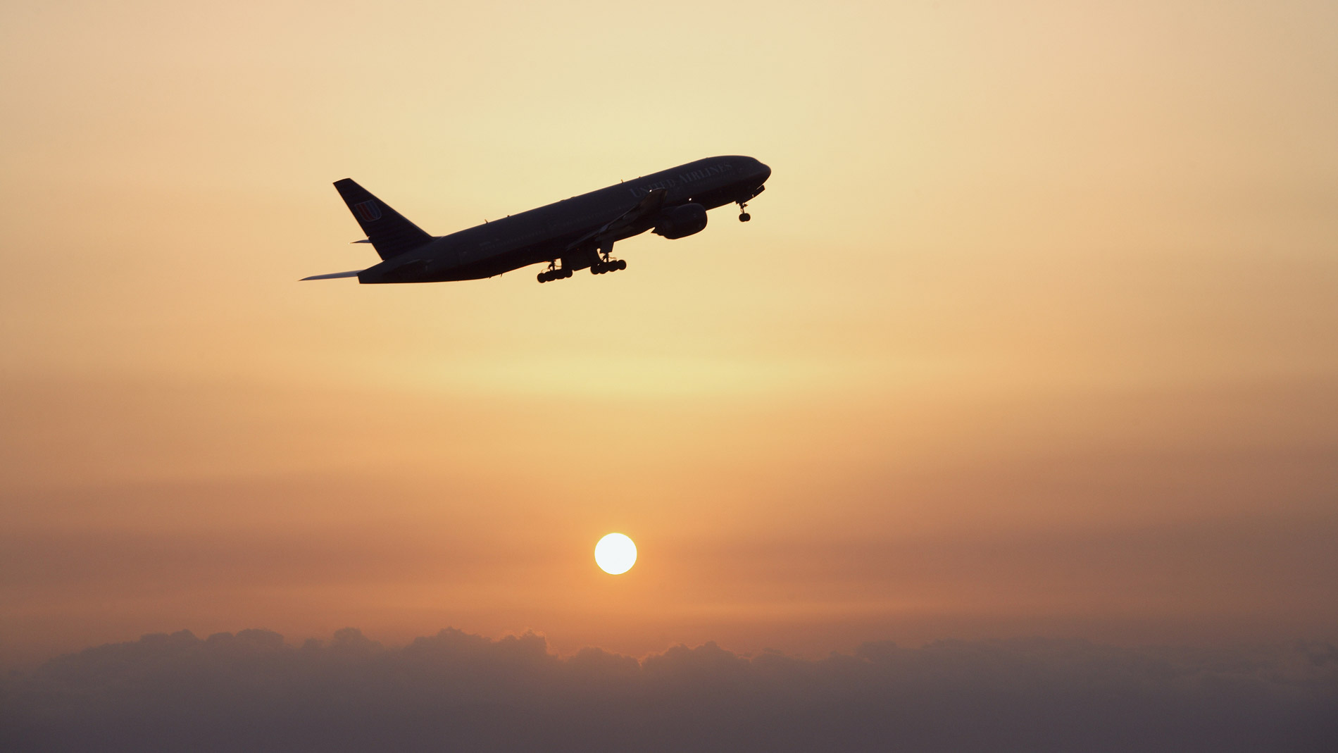 Airplane flying, sunset, low angle view, Central Japan International Airport, Tokoname City, Aichi Prefecture, Chubu Region, Japan