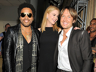 Singer Lenny Kravitz, left, actress Nicole Kidman and country singer Keith Urban pose at the 2013 CMT Music Awards at Bridgestone Arena on Wednesday, June 5, 2013, in Nashville, Tenn.