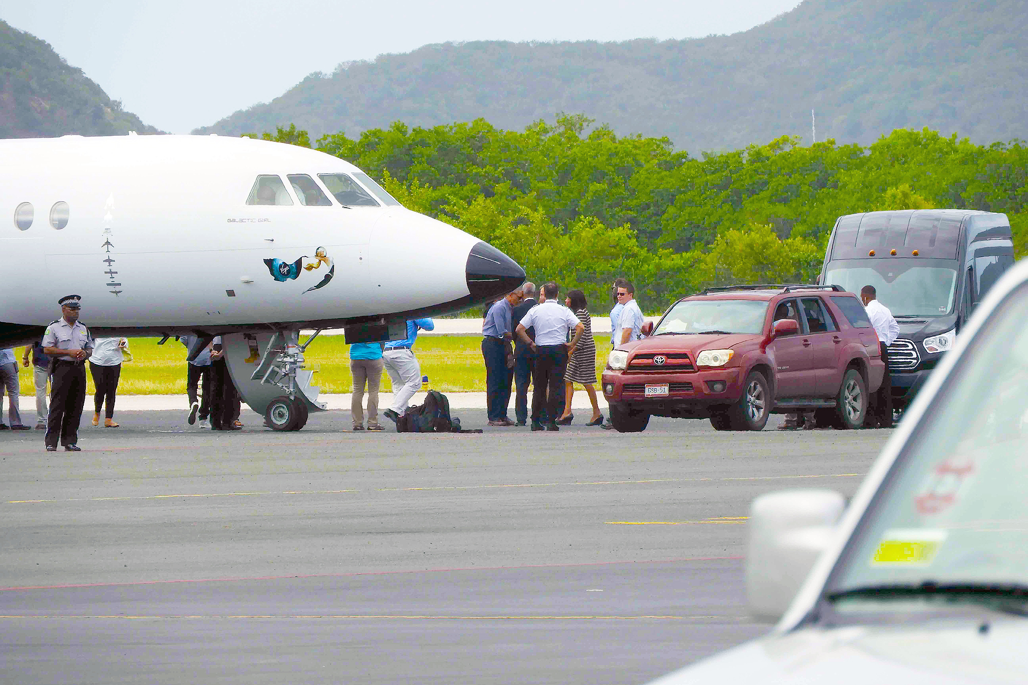 The former first couple were seen flying out of the British Virgin Islands on February 2nd after spending over a week in the Carribbean. The Obama's arrived at Tortola airport via helicopter on Thursday evening before catching a jet back to Washington DC. It is believed they had been holidaying on Richard Branson's nearby private island called Moskito. Pictured: Barack and Michelle Obama seen leaving the British Virgin Islands Ref: SPL1429988 020217 Picture by: Katie King / Splash News Splash News and Pictures Los Angeles: 310-821-2666 New York: 212-619-2666 London: 870-934-2666 photodesk@splashnews.com