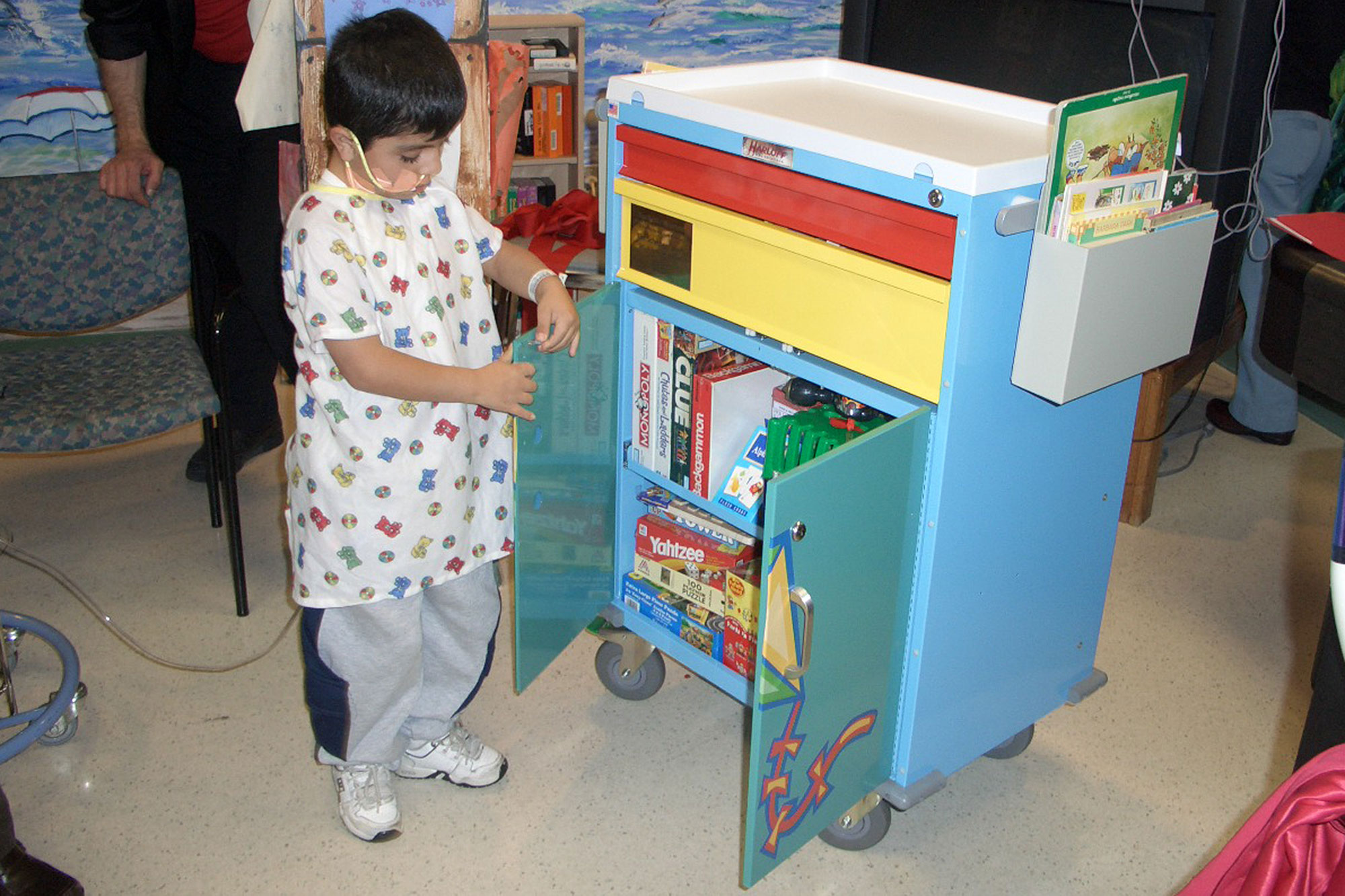 Photos of children using play stations and getting toys are at the pediatric floor of Miller Children's and Women's Hospital in Long Beach, California.