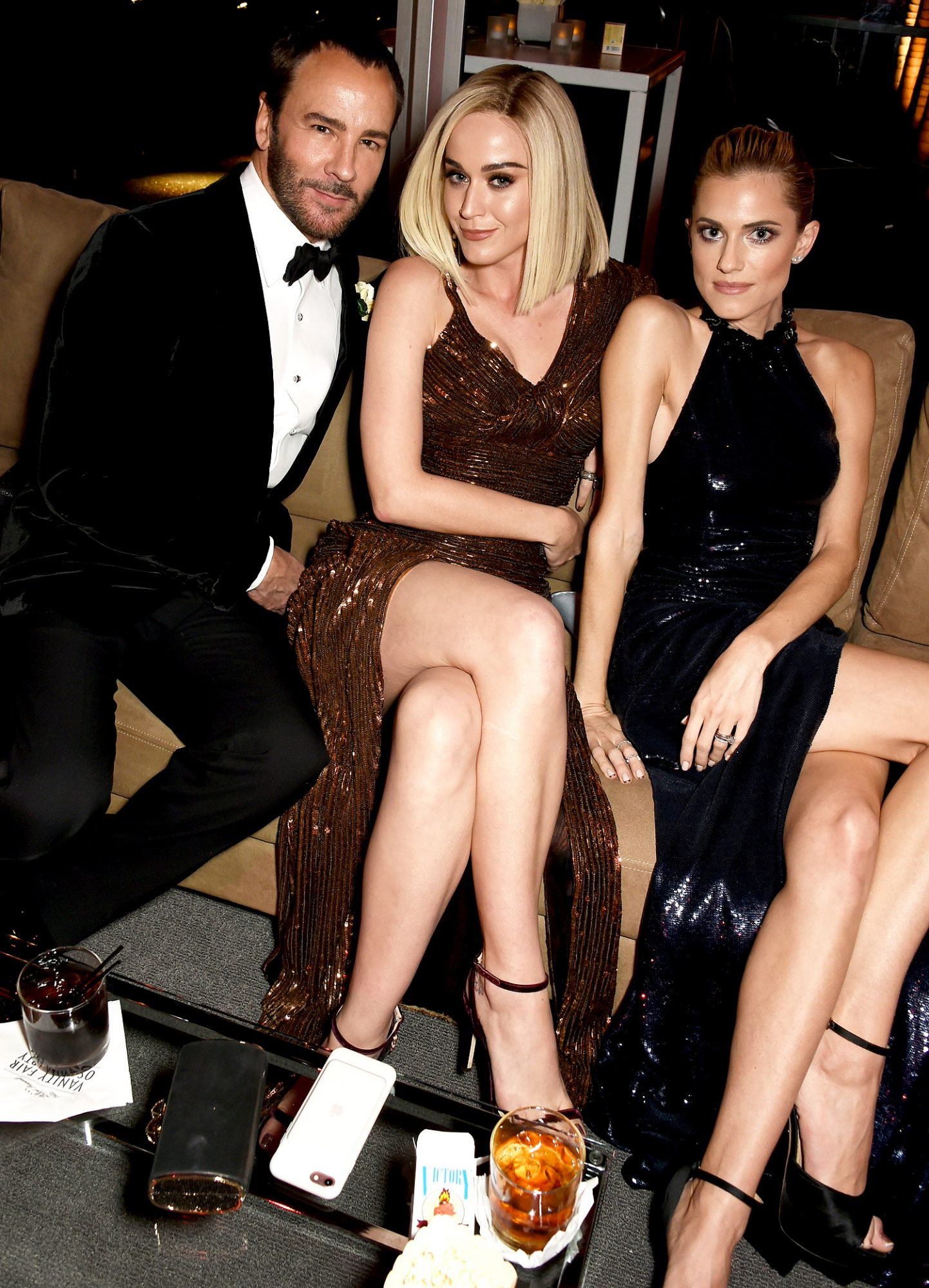 BEVERLY HILLS, CA - FEBRUARY 26: (L-R) Designer Tom Ford, singer-songwriter Katy Perry, and actor Allison Williams attend the 2017 Vanity Fair Oscar Party hosted by Graydon Carter at Wallis Annenberg Center for the Performing Arts on February 26, 2017 in Beverly Hills, California. (Photo by Dave M. Benett/VF17/WireImage)