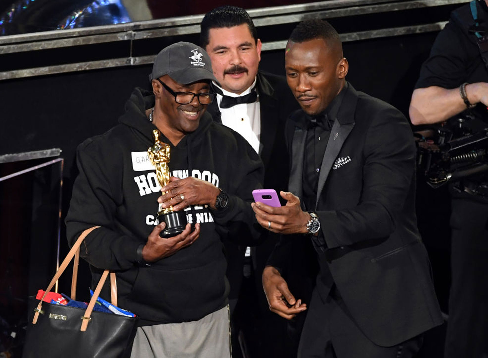 HOLLYWOOD, CA - FEBRUARY 26: Guillermo Rodriguez (C) and actor Mahershala Ali (R) surprises tourists with an entrance to the 89th Annual Academy Awards at Hollywood & Highland Center on February 26, 2017 in Hollywood, California. (Photo by Kevin Winter/Getty Images)