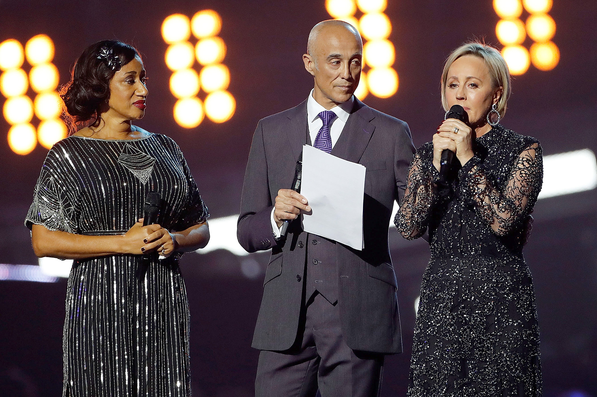 """LONDON, ENGLAND - FEBRUARY 22:  EDITORIAL USE ONLY.  (L-R) Helen """"Pepsi"""" DeMacque, Andrew Ridgeley and Shirlie Holliman pay tribute to George Michael on stage at The BRIT Awards 2017 at The O2 Arena on February 22, 2017 in London, England.  (Photo by David M. Benett/Dave Benett/Getty Images )"""