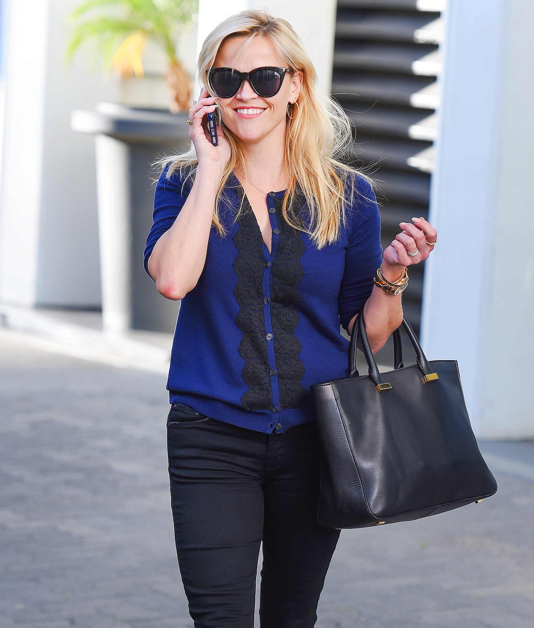 Reese Witherspoon talks on her phone out in Los Angeles