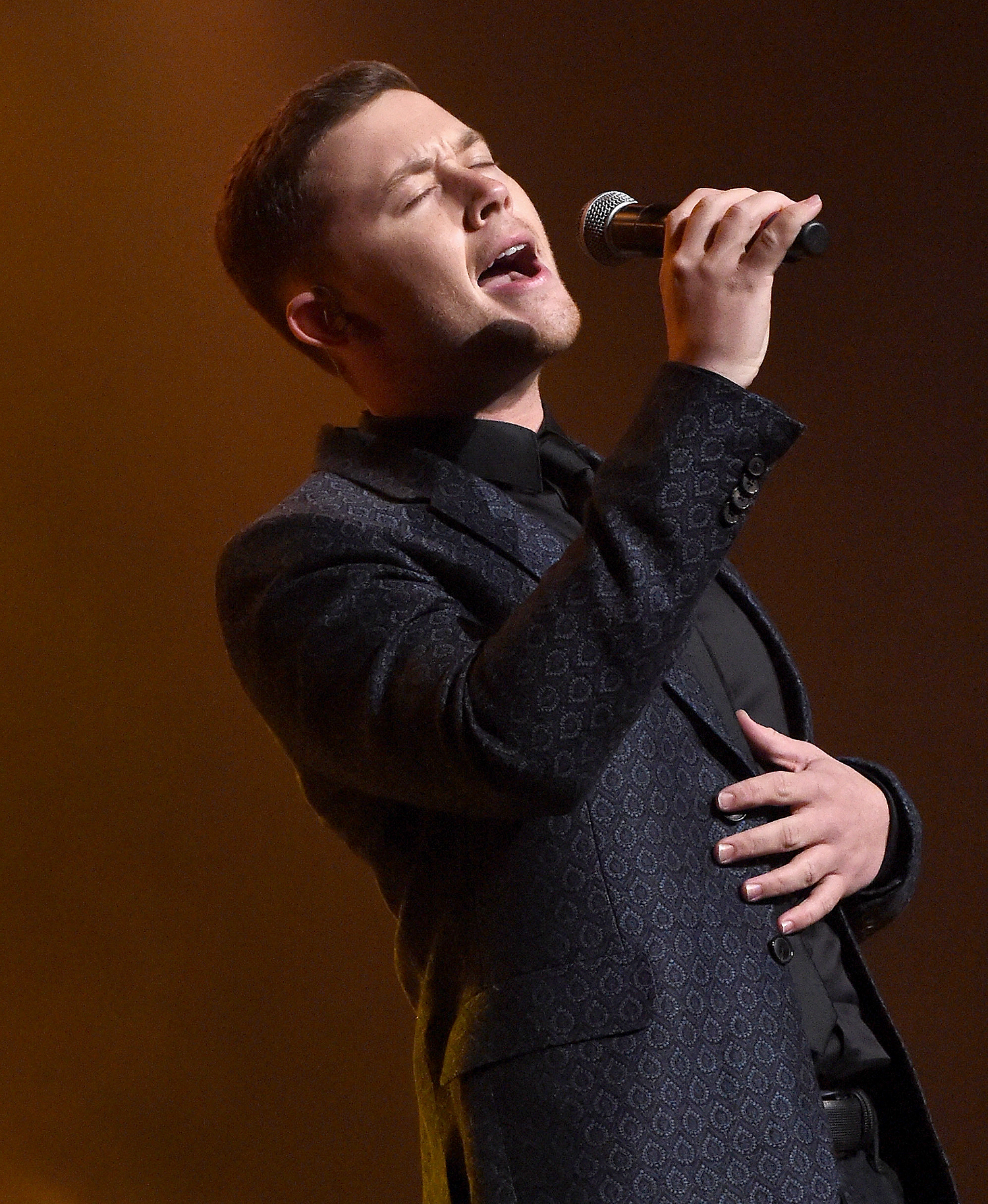 NASHVILLE, TN - FEBRUARY 08: Scotty McCreery performs during 1 Night. 1 Place. 1 Time: A Heroes & Friends Tribute to Randy Travis at Bridgestone Arena on February 8, 2017 in Nashville, Tennessee. (Photo by Rick Diamond/Getty Images for Outback Concerts)