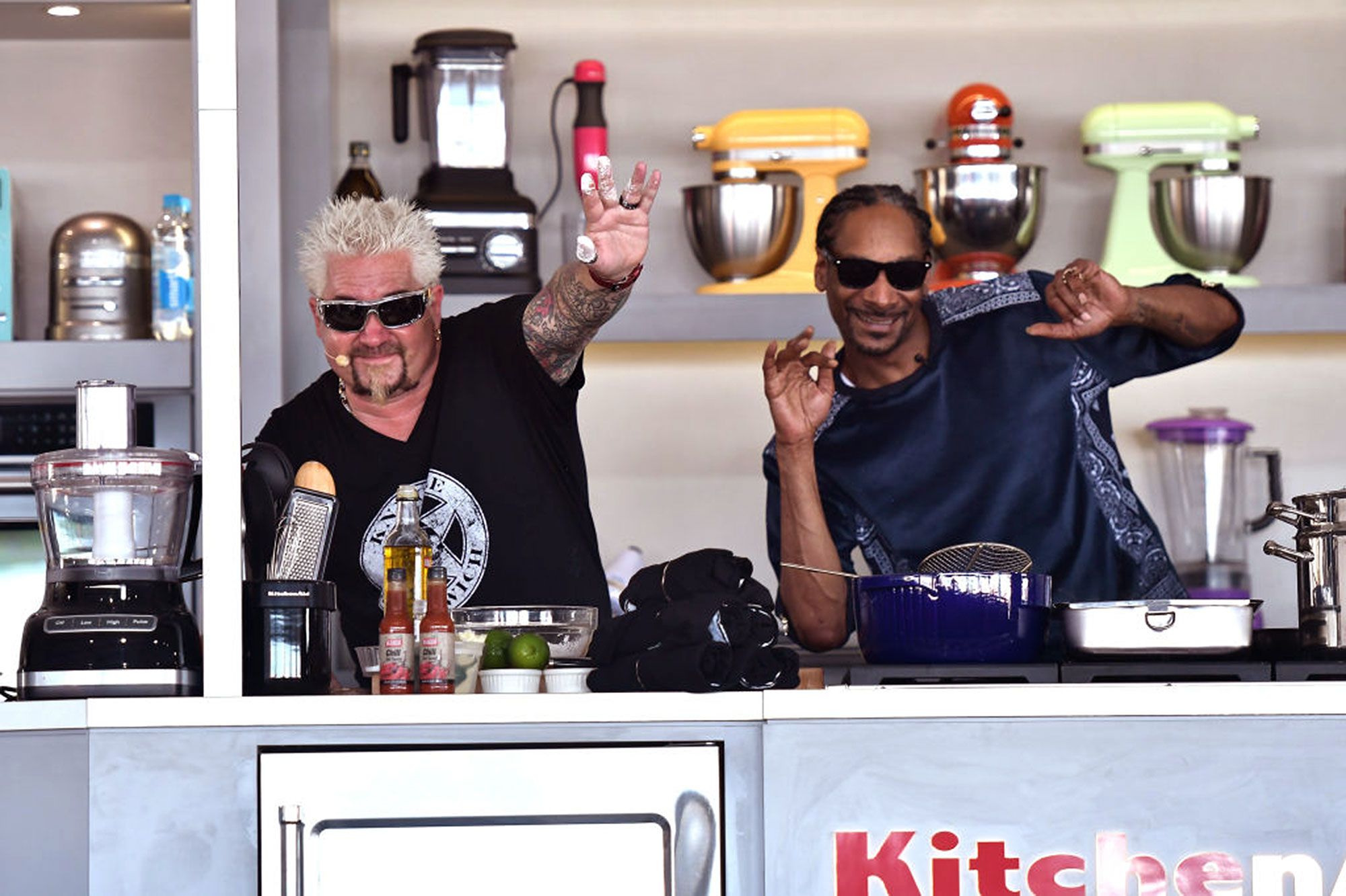 MIAMI BEACH, FL - FEBRUARY 25: Guy Fieri and Snoop Dogg cook on stage at Goya Foods' Grand Tasting Village Featuring Mastercard Grand Tasting Tents & KitchenAid Culinary Demonstrations on February 25, 2017 in Miami Beach, Florida. (Photo by Gustavo Caballero/Getty Images for SOBEWFF)