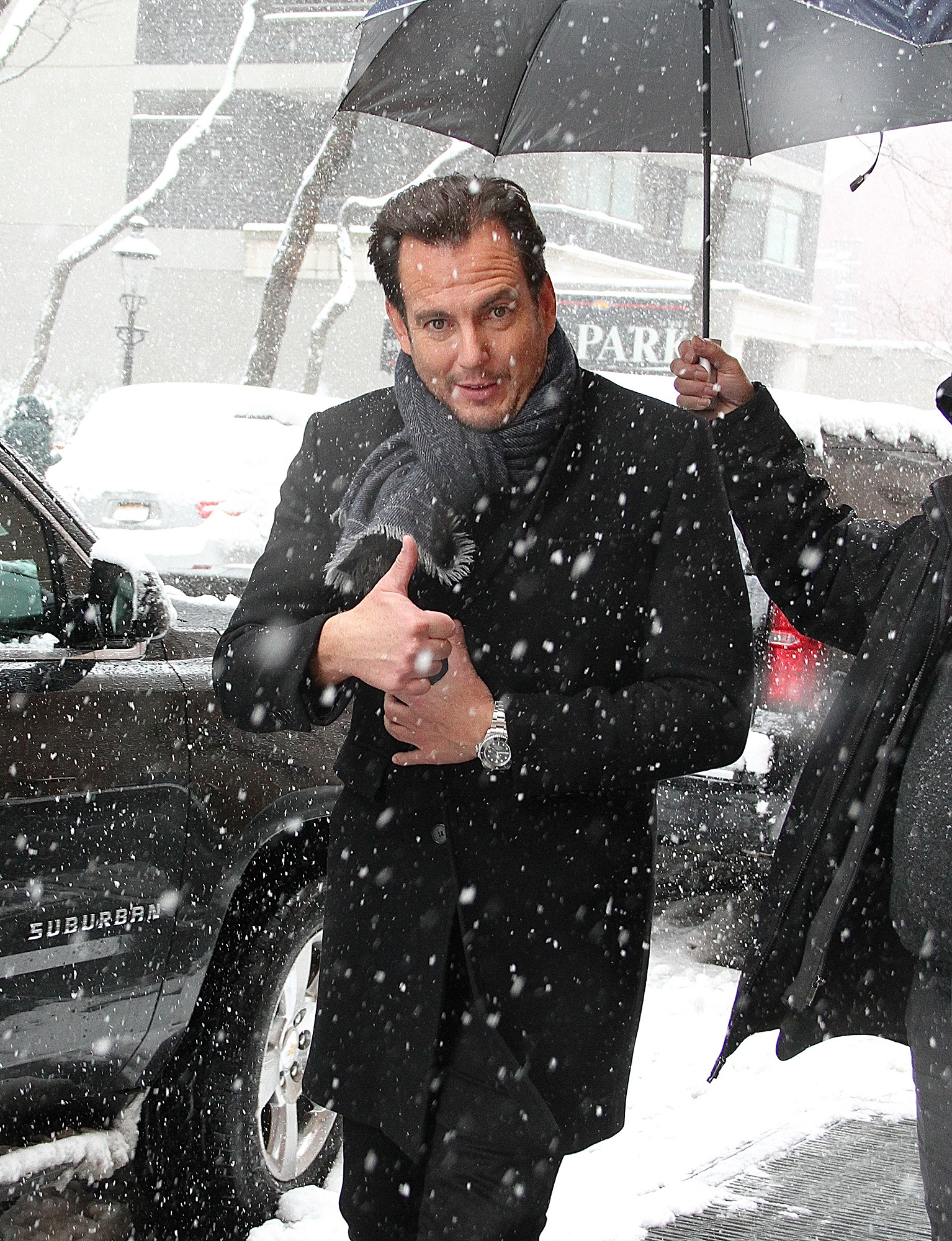 'The LEGO Batman Movie' star Will Arnett gives a thumbs up as he braves a snowstorm as he leaves 'The View' in NYC