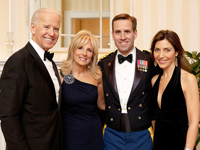 """Vice President Joe Biden and Dr. Jill Biden take photos with their Son Beau Biden and Hallie Biden in the foyer of the Naval Observatory residence before the """"A Nations Gratitude Dinner"""", February 29, 2012."""