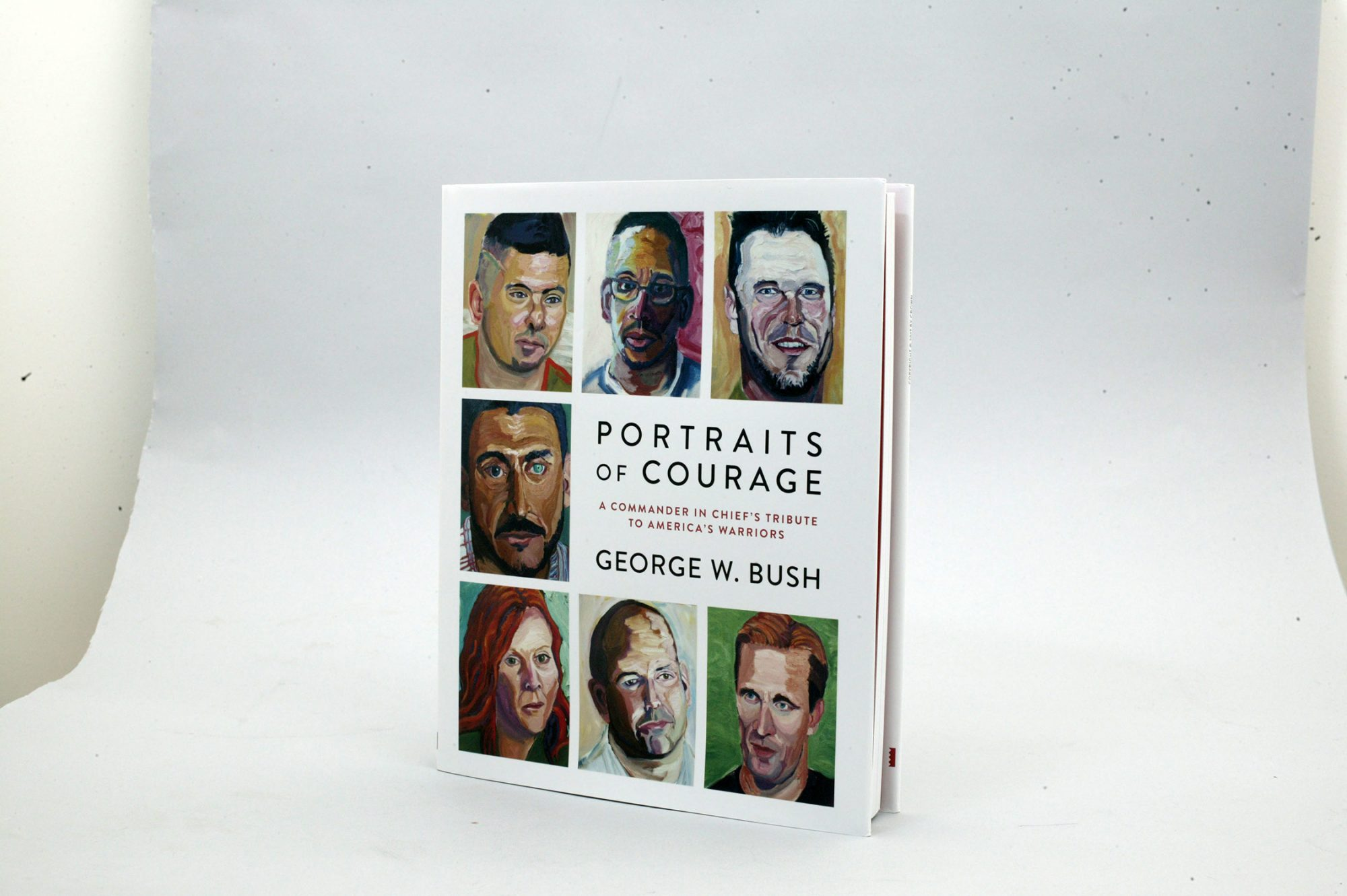 """Book cover for """"Portraits of courage: A Commander in Chief's Tribute to America's Warriors"""" painted portrait of Veterans by George W. Bush. Credit: Peter Zambouros"""