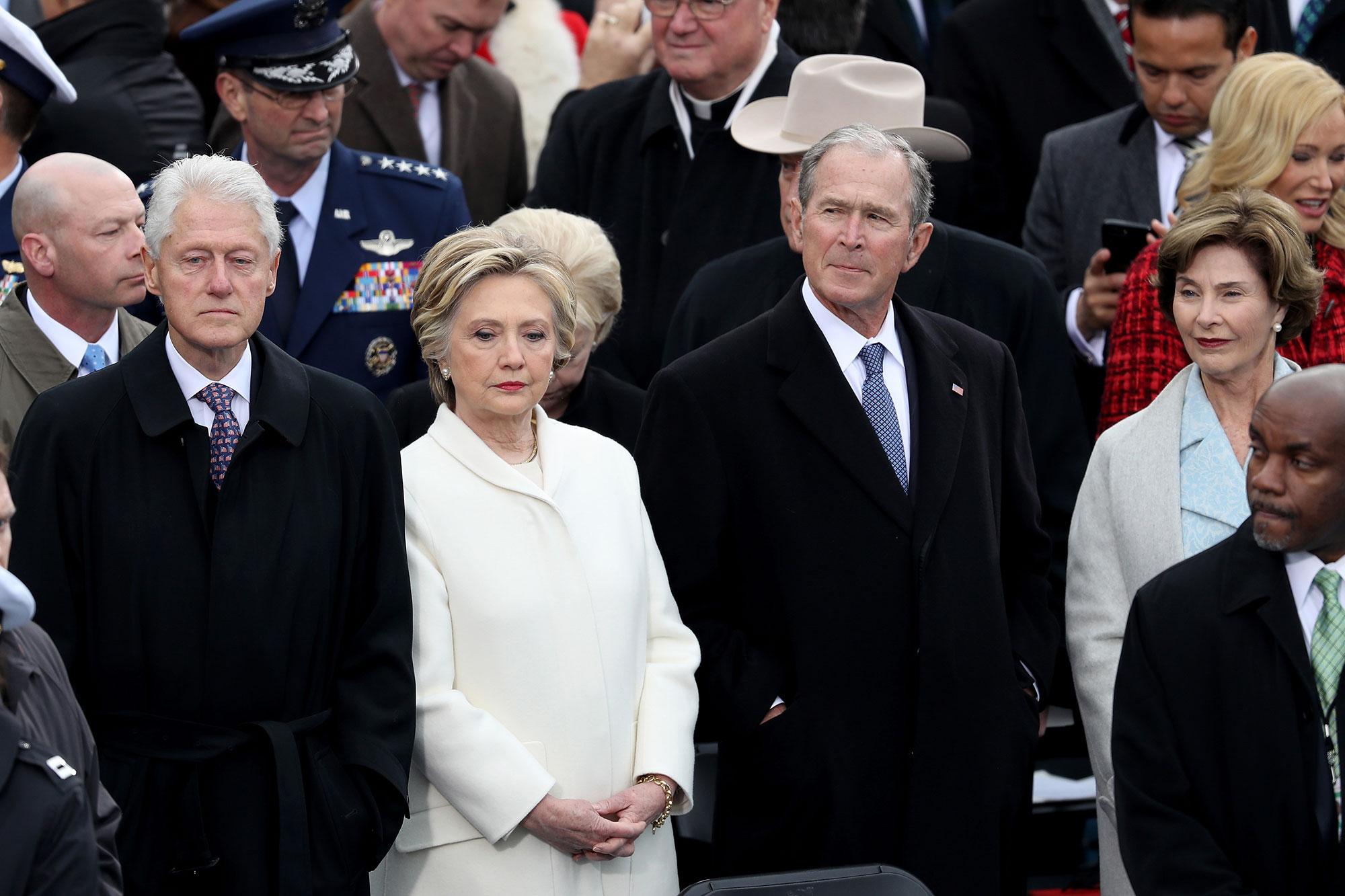 WASHINGTON, DC - JANUARY 20: Former President Bill Clinton (L), former Democratic presidential nominee Hillary Clinton, former President George W. Bush and Laura Bush stand on the West Front of the U.S. Capitol on January 20, 2017 in Washington, DC. In today's inauguration ceremony Donald J. Trump becomes the 45th president of the United States. (Photo by Joe Raedle/Getty Images)