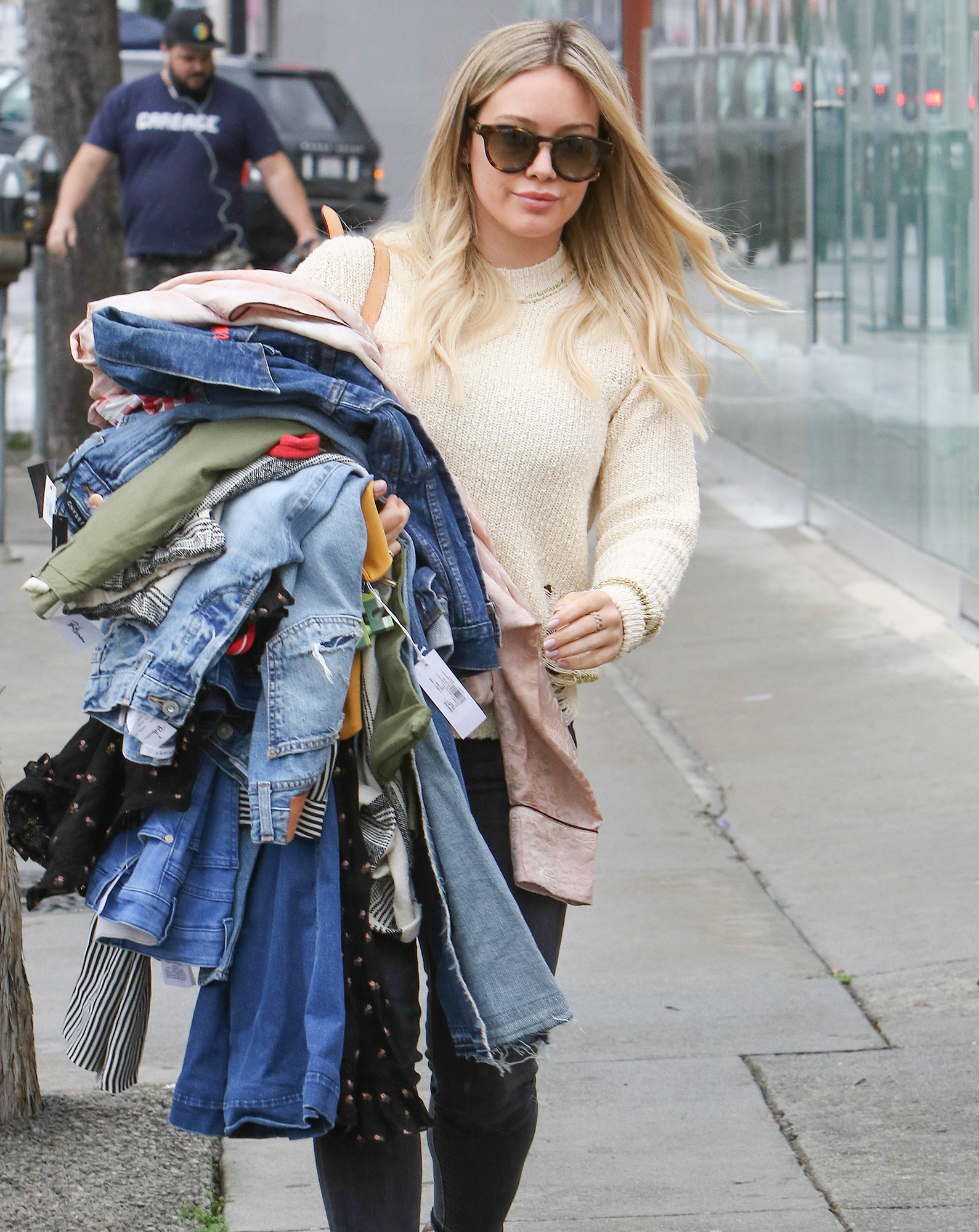 Hillary Duff going to Marinas Tailoring in West Ho with a tons of clothing .