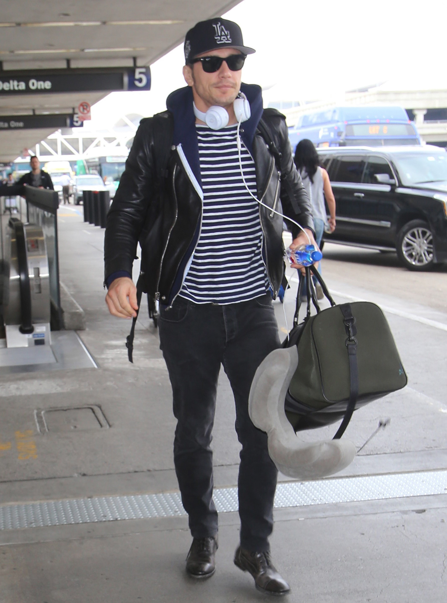 James Franco gets the finger from an unhappy autograph hunter as he departs LAX