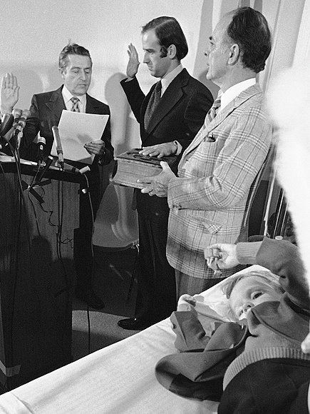 FILE - In this Jan. 5, 1973 file photo, four-year-old Beau Biden, foreground, plays near his father, Joe Biden, center, being sworn in as the U.S. senator from Delaware, by Senate Secretary