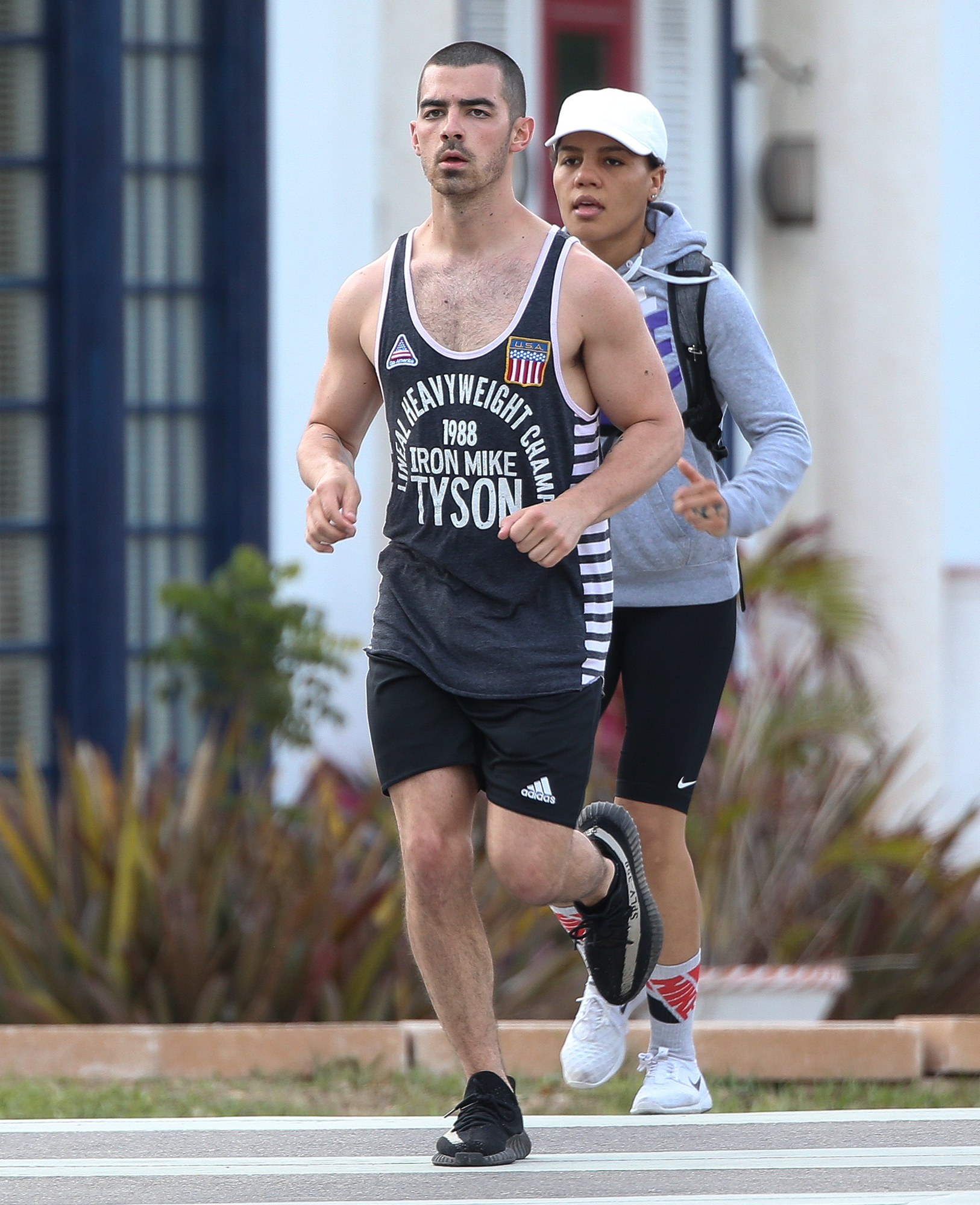 EXCLUSIVE: Joe Jonas shows off his biceps as he pounds the pavement on his day off in Miami