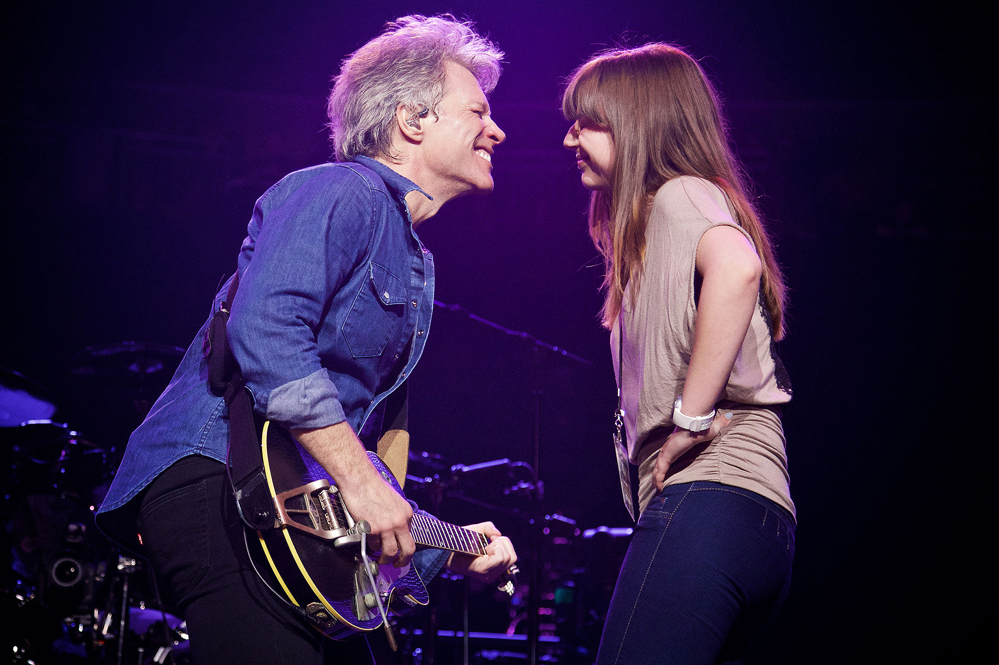 """Mandatory photo credit: Photo by David Bergman / TourPhotographer.com for Bon Jovi February 25, 2017 -- During the song, """"I Got the Girl,"""" Jon Bon Jovi dances with his daughter Stephanie Bongiovi, 23, on stage at T-Mobile Arena in Las Vegas, NV during his band's """"This House is Not For Sale"""" tour. He wrote the song when she was a child and she danced with him on stage when she was around seven years old. It was a surprise for the Las Vegas crowd when he played the song and called her out to join him."""