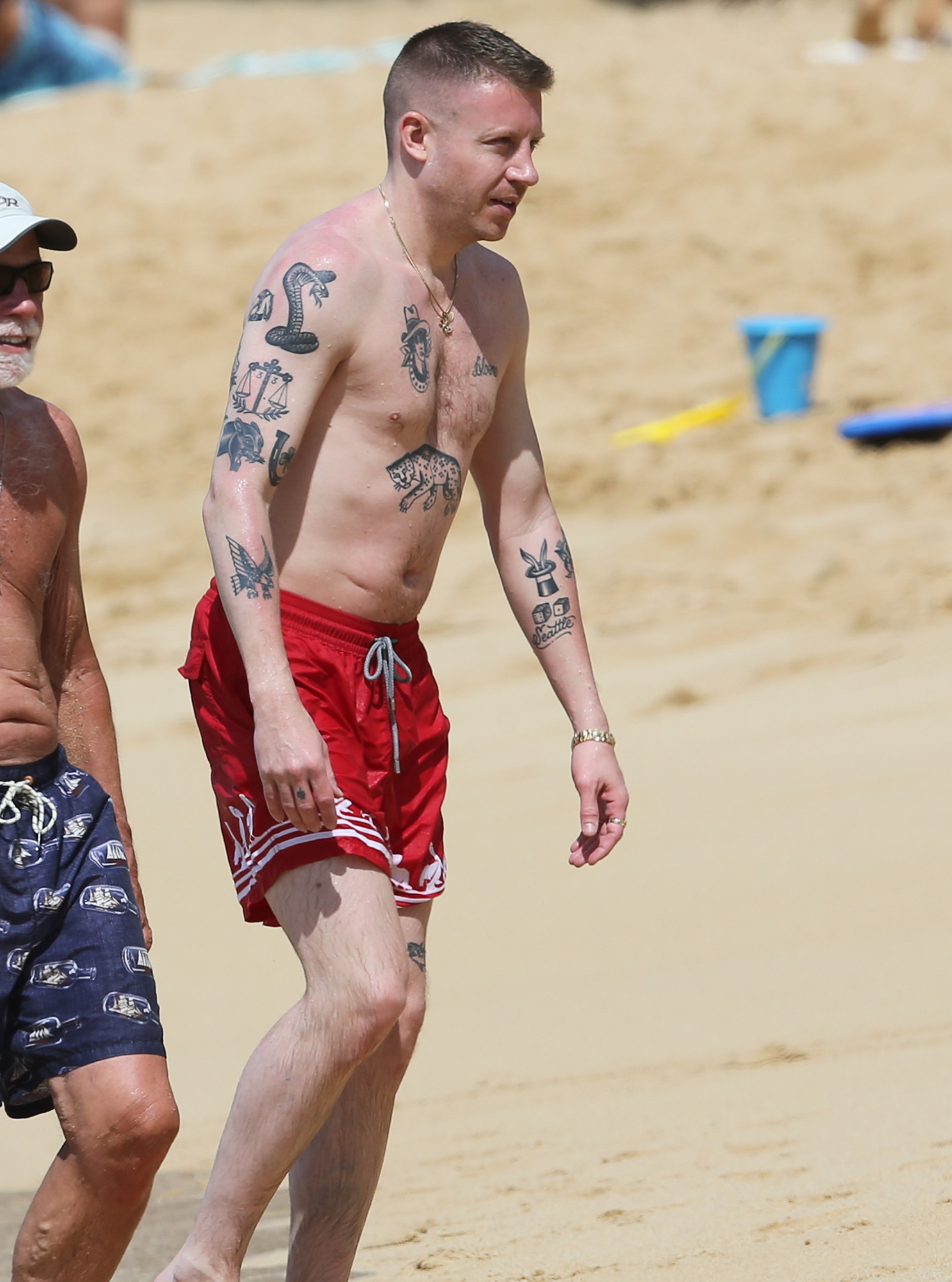 EXCLUSIVE: A shirtless Macklemore enjoys a beautiful day at the beach in Hawaii.