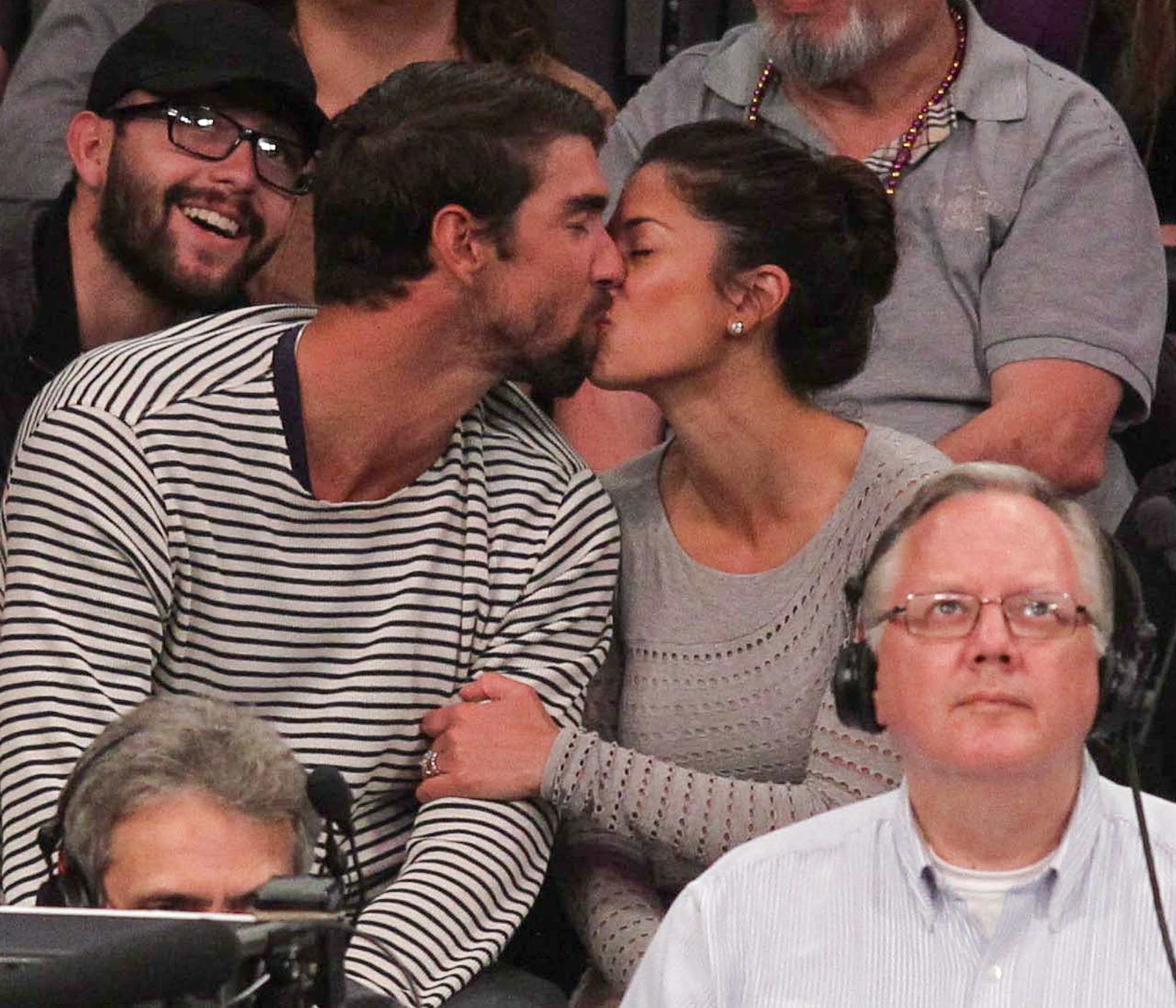 Michael Phelps watches the Lakers with Nicole Johnson in Los Angeles