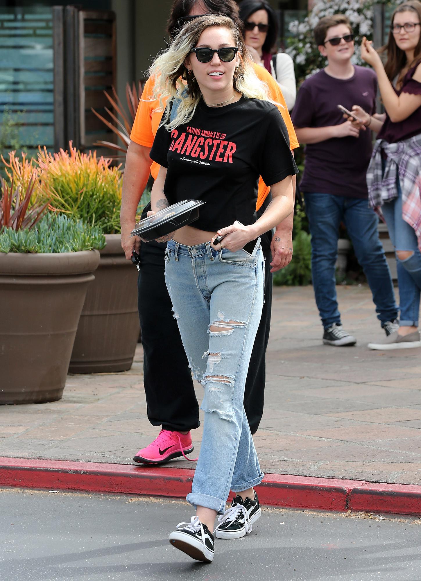 Miley Cyrus leaving a restaurant in Malibu with her engagement ring on show
