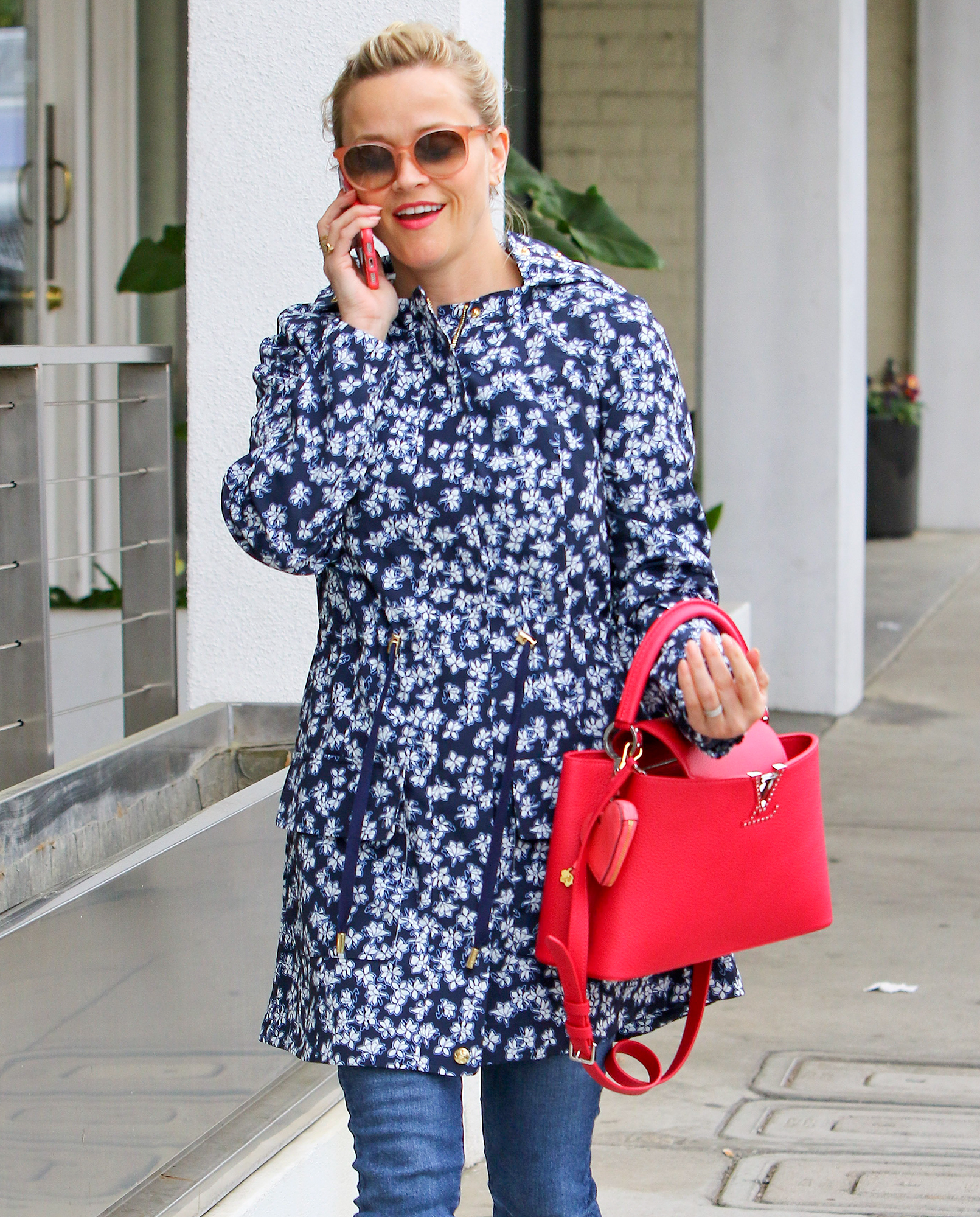 EXCLUSIVE: Reese Whiterspoon looks chick in jeans and a blue floral coat while shopping in Brentwood.