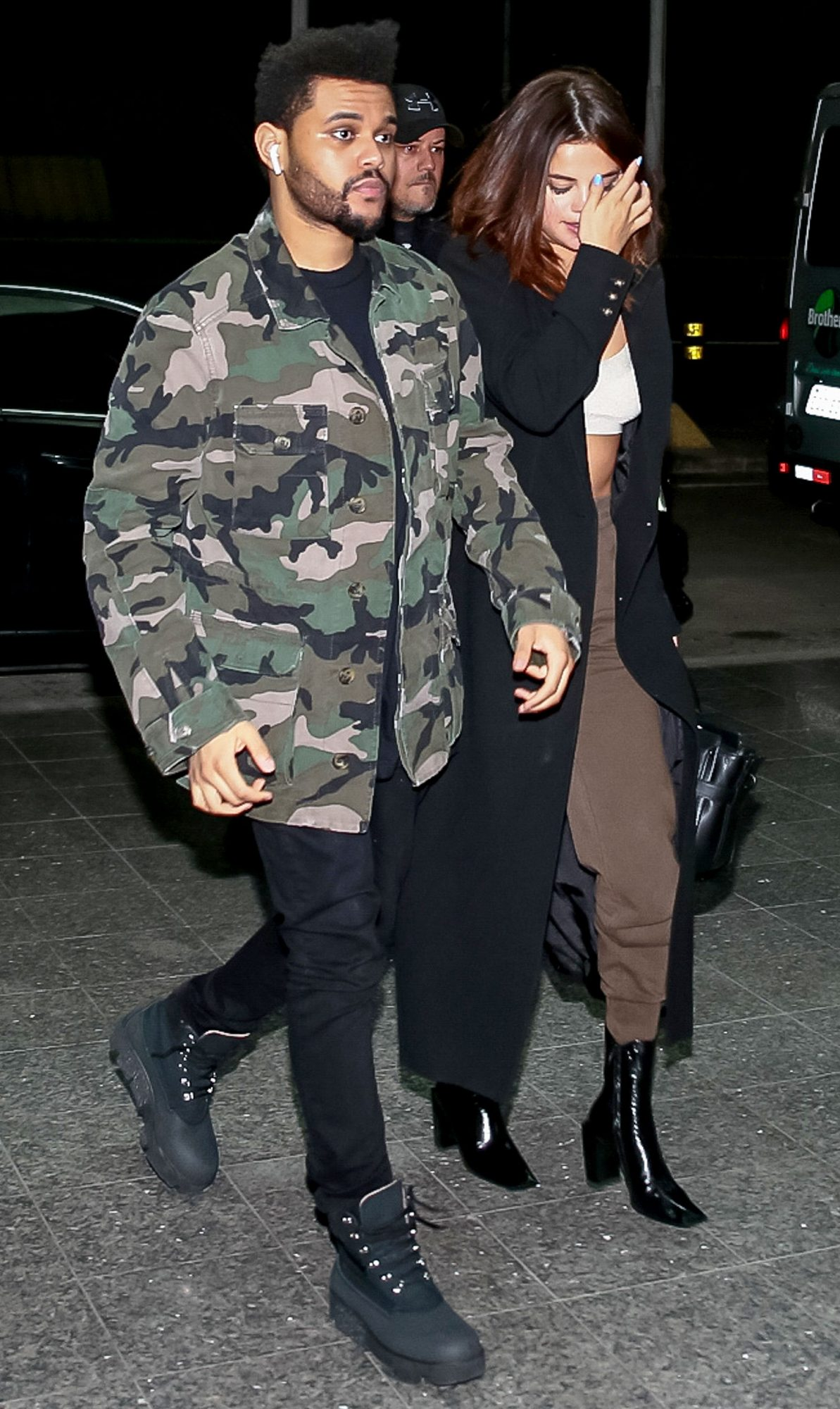 *EXCLUSIVE* The Weeknd and Selena Gomez keep close on their way to a flight after Lollapalooza Brazil