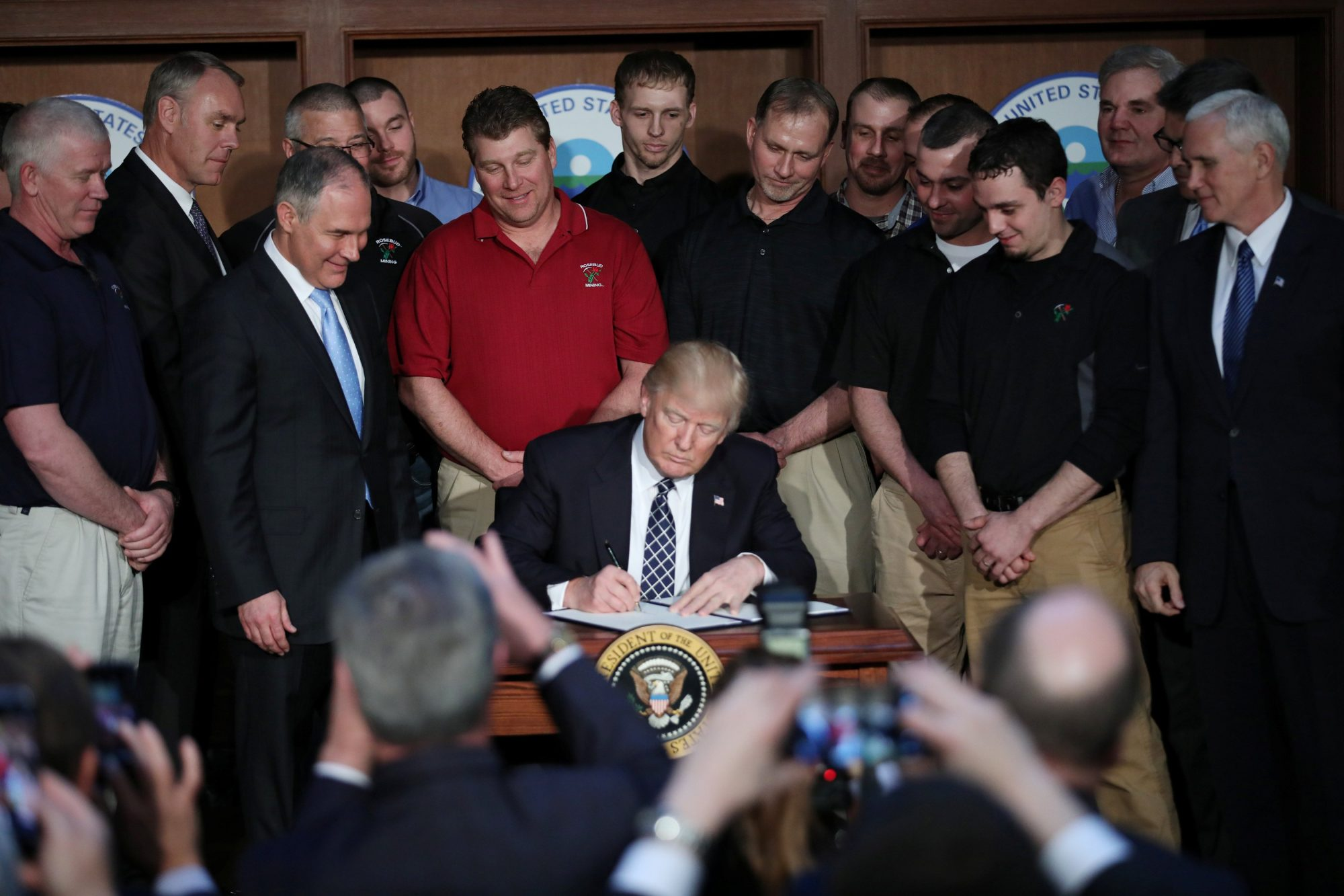 "U.S. President Trump signs an executive order on ""energy independence"" during event at EPA headquarters in Washington"