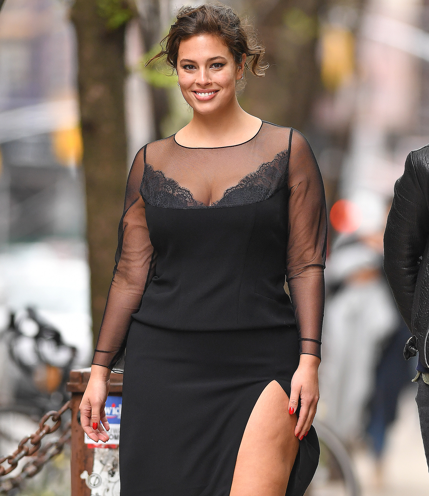 Ashley Graham seen wearing a black lace dress for a Harper's Bazaar UK photo shoot in New York City