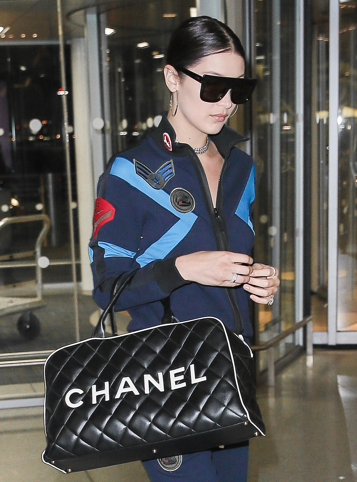 EXCLUSIVE: Bella Hadid wears a flight suit as she jets from JFK airport
