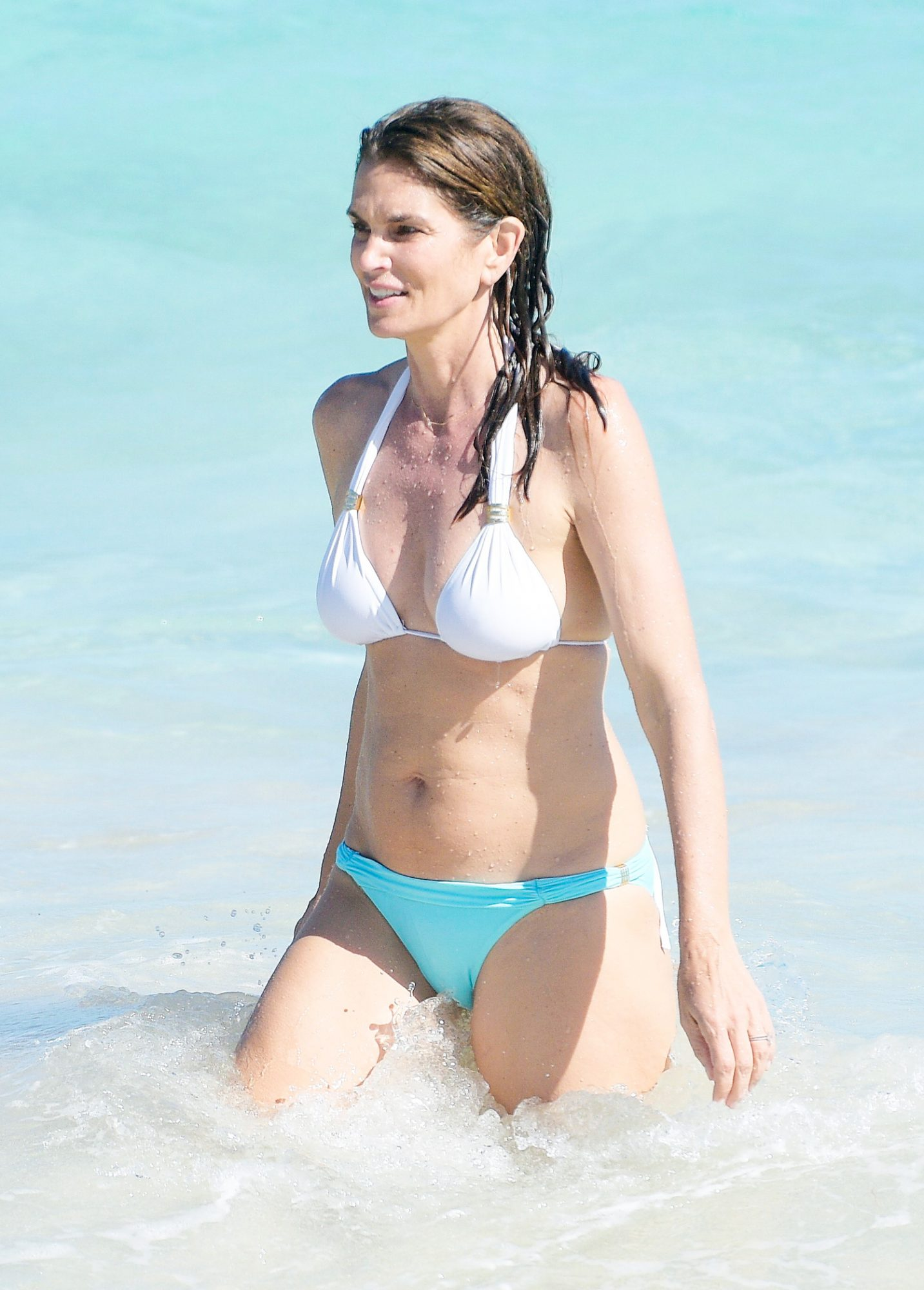 Cindy Crawford and Rande Gerber have fun in the sea while on holiday with Kaia