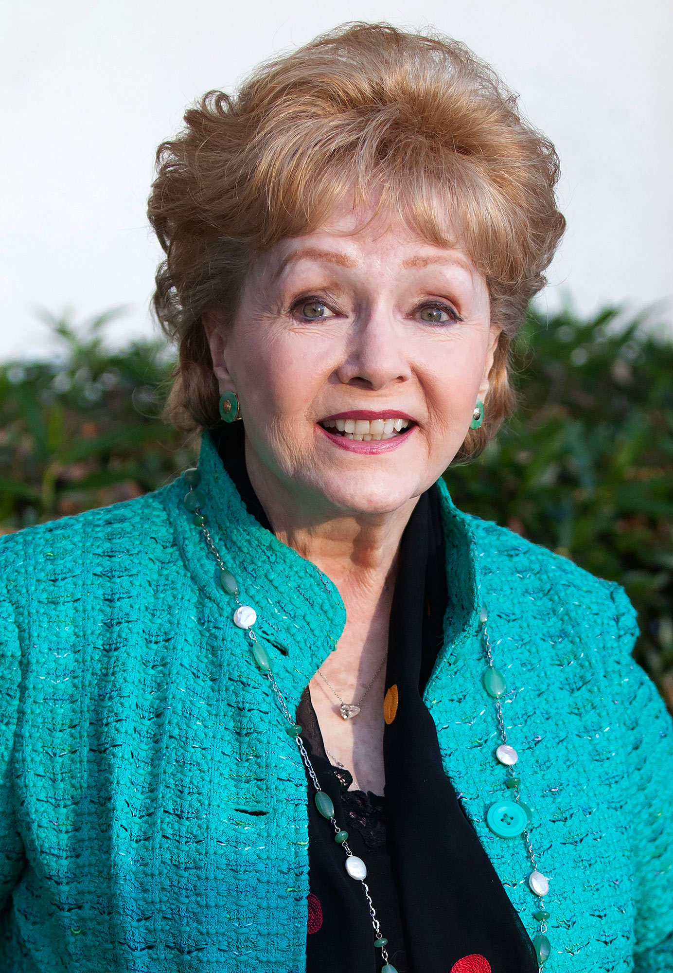 "FILE - DECMEBER 28: According to reports December 28, 2016 Debbie Reynolds was rushed to a Los Angeles area hospital with a possible stroke. Reynolds is the mother of Carrie Fisher who died December 27 after suffering a heart attack days earlier. WEST HOLLYWOOD, CA - SEPTEMBER 29: Debbie Reynolds arrives for the signing of her book, ""Unsinkable,"" on September 29, 2013 in West Hollywood, California. (Photo by Gabriel Olsen/FilmMagic)"