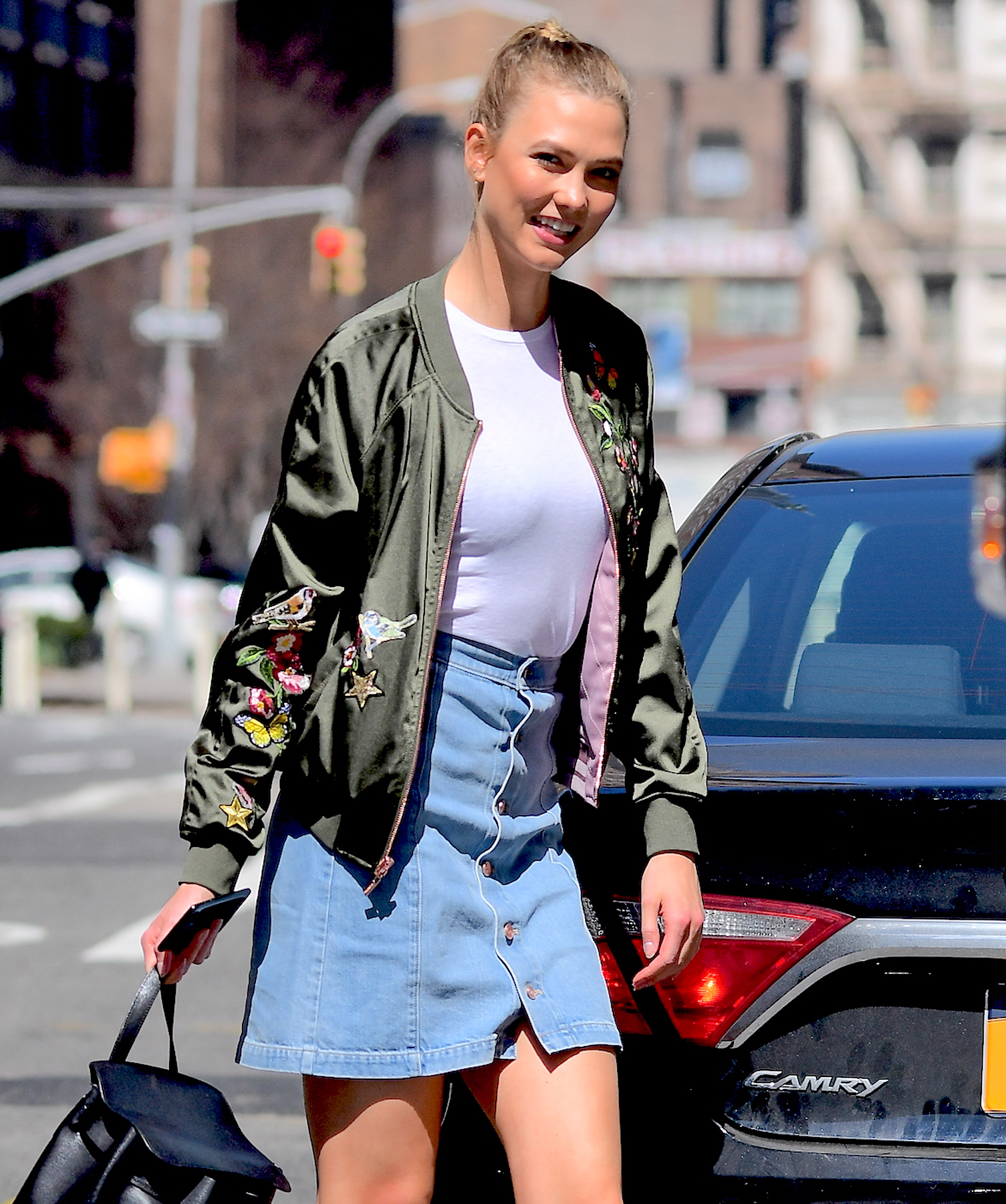EXCLUSIVE: Karlie Kloss Wears Denim Skirt as she Visits the Express Store in Soho to see her New Collection