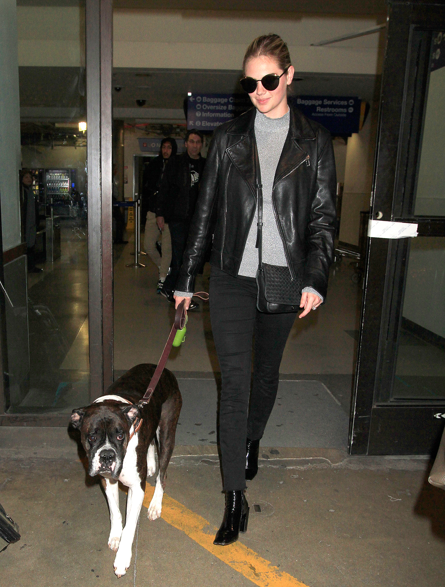 EXCLUSIVE: Kate Upton looks stunning with her dog, Harley as they arrive in Los Angeles.  The supermodel was seen at LAX with black pants and boots with a black leather jacket and sunglasses.
