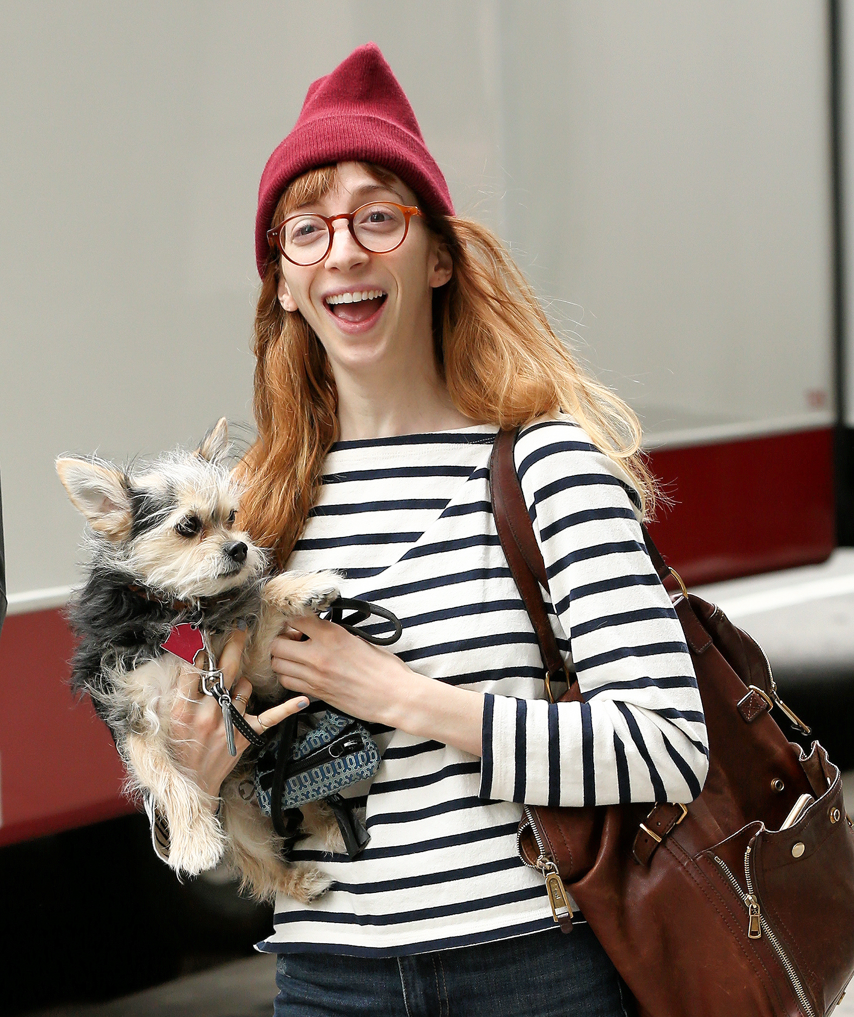 Actress Molly Bernard carries her dog to the set of 'Younger' filming in New York