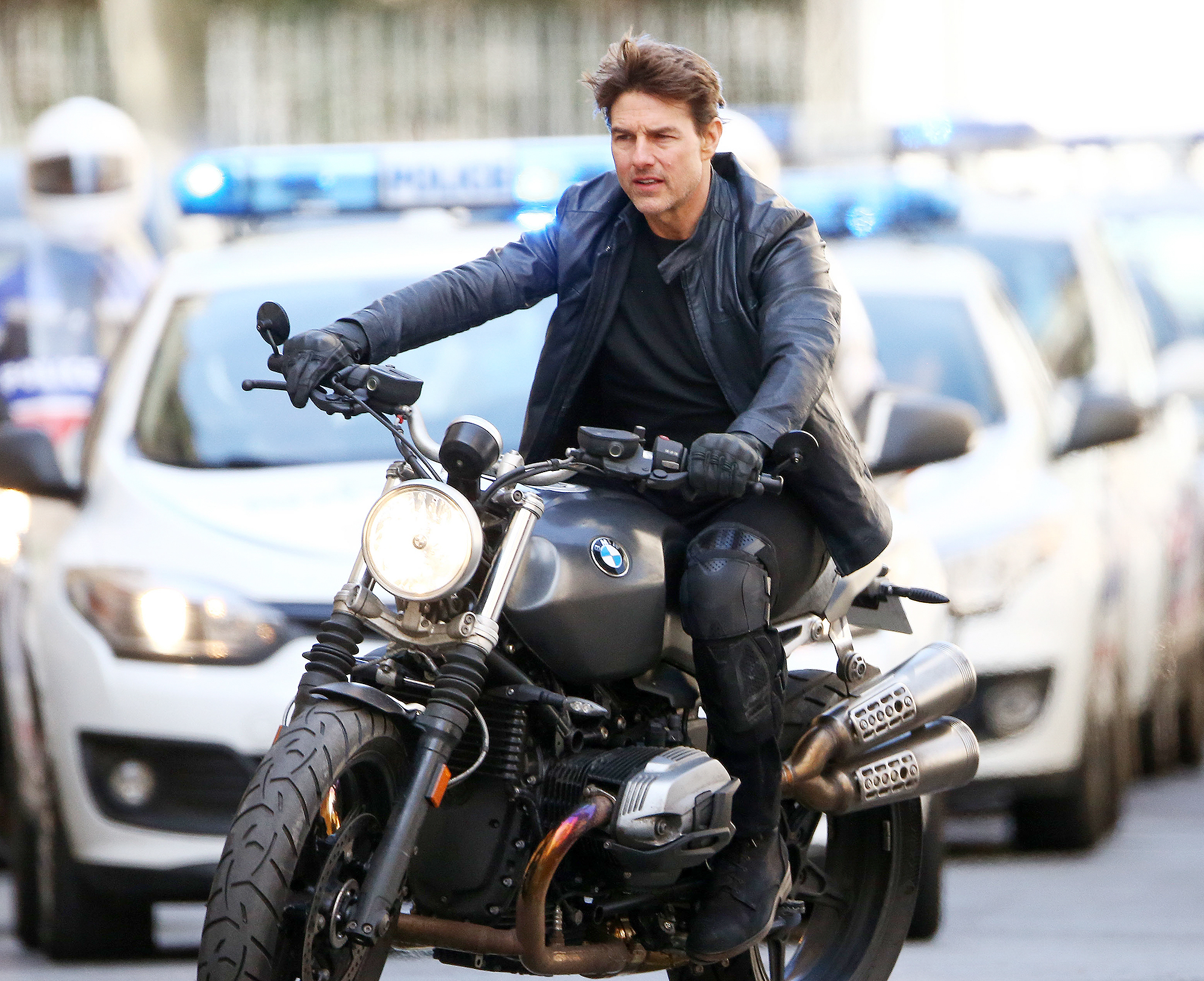 Tom Cruise riding bike on the set of Mission Impossible 6