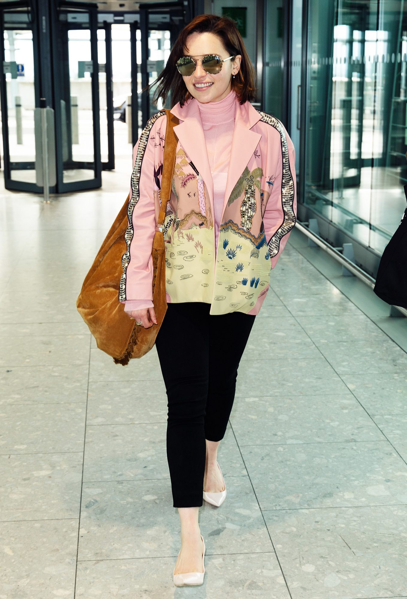 EXCLUSIVE: Emilia Clarke spotted departing Heathrow Airport