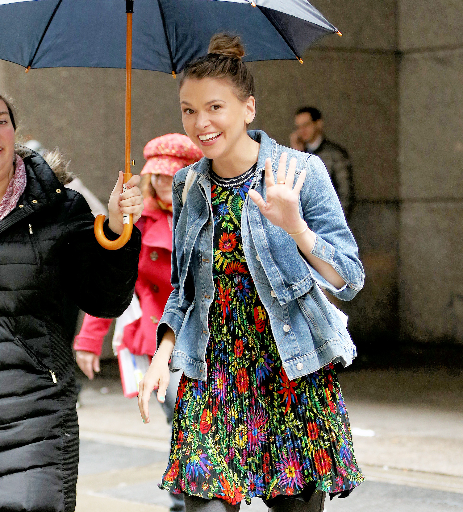 Actress Sutton Foster walks under an umbrella to the set of 'Younger' filming at Hotel Pennsylvania in New York City