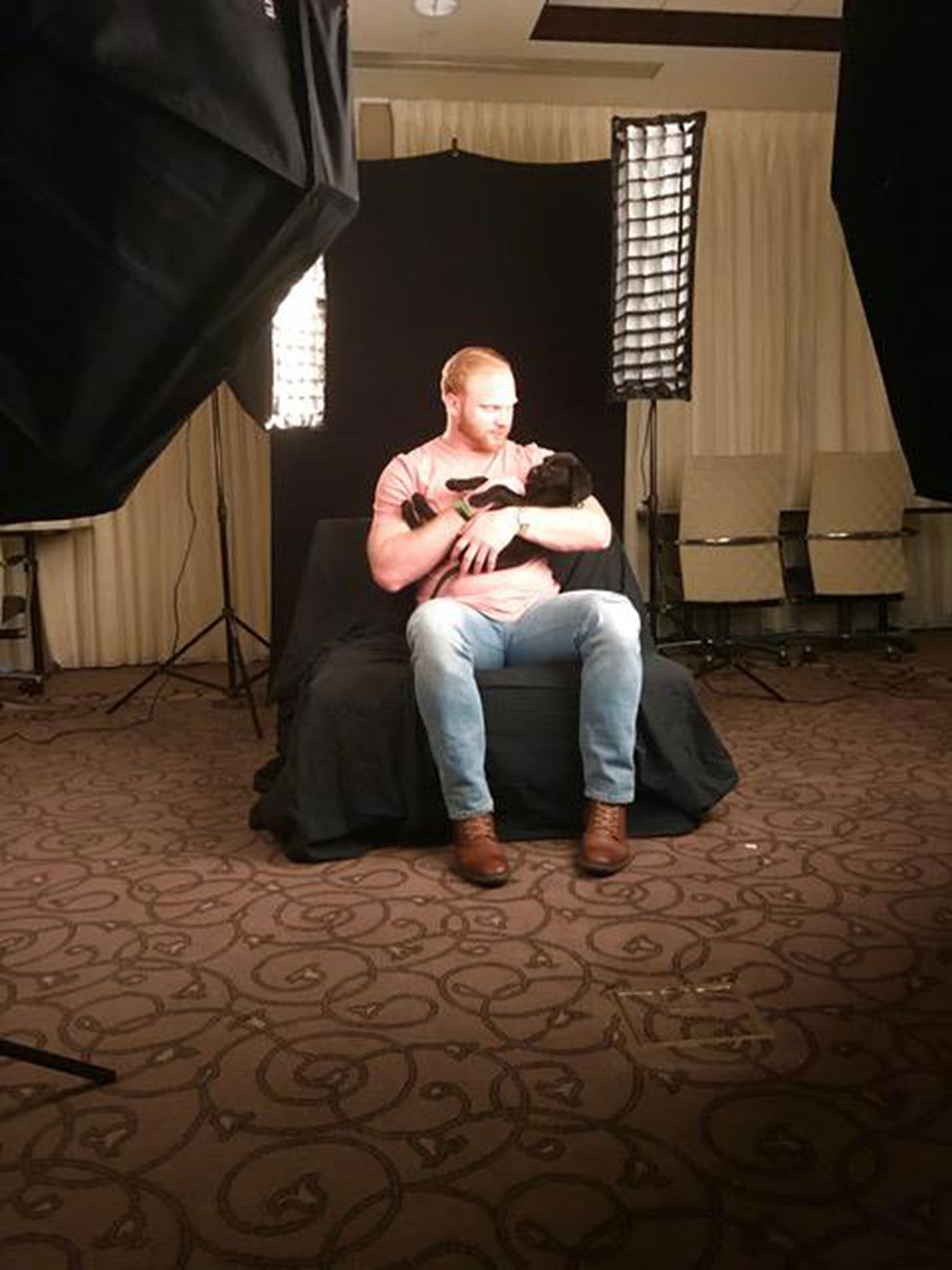 Tyler Matakevich with puppyCredit: Show Your Soft Side